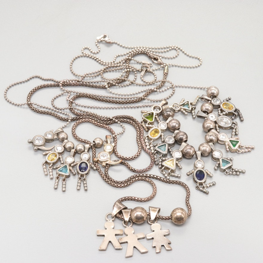 Collection of Sterling Silver Cubic Zirconia and Glass Kid Charm Necklaces