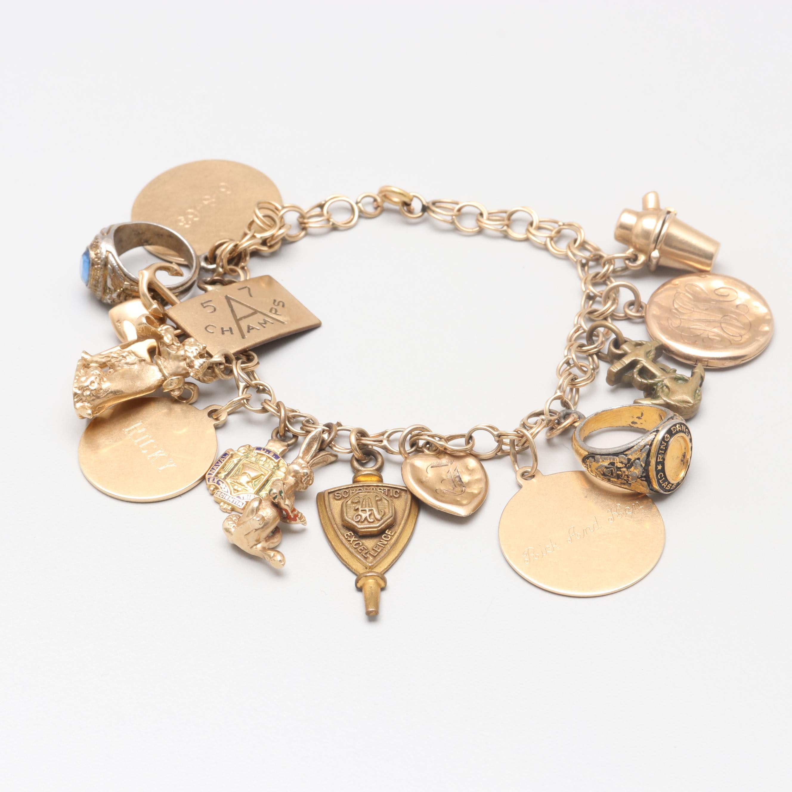 14K Yellow Gold Charm Bracelet with 14K, 10K Yellow Gold and Gold Tone Charms