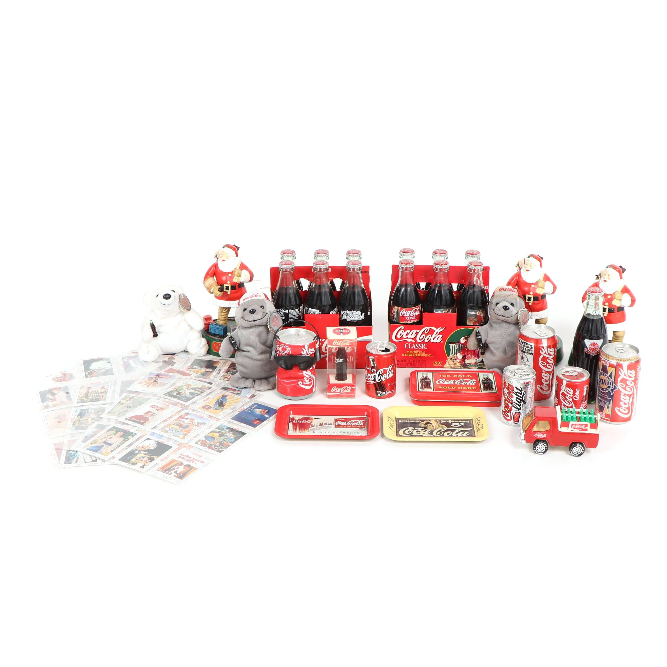 Coca-Cola Bottles, Cans, Figurines and Other Memorabilia