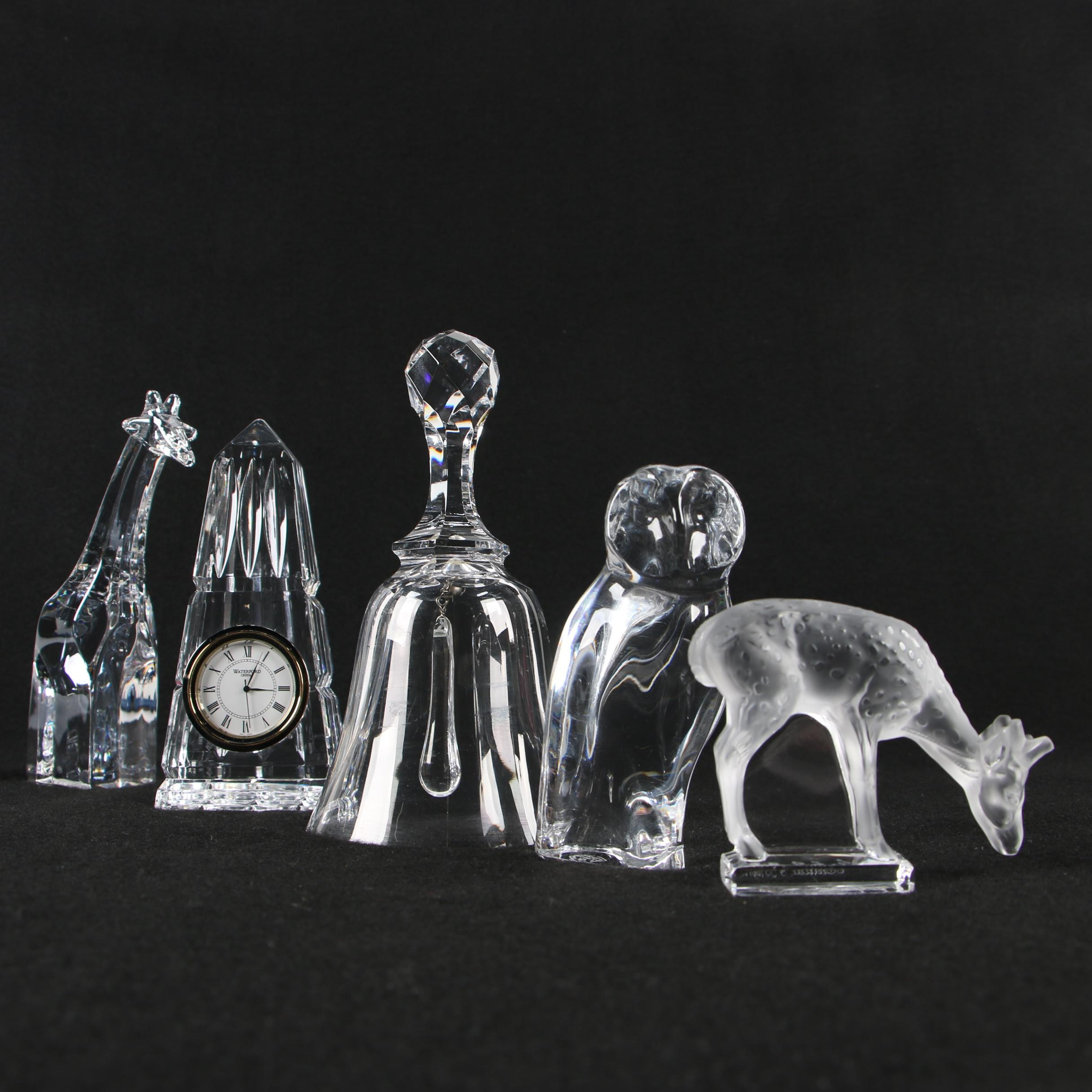 Lalique Deer, Orrefors Giraffe, Baccarat Owl and Bell, with Waterford Desk Clock