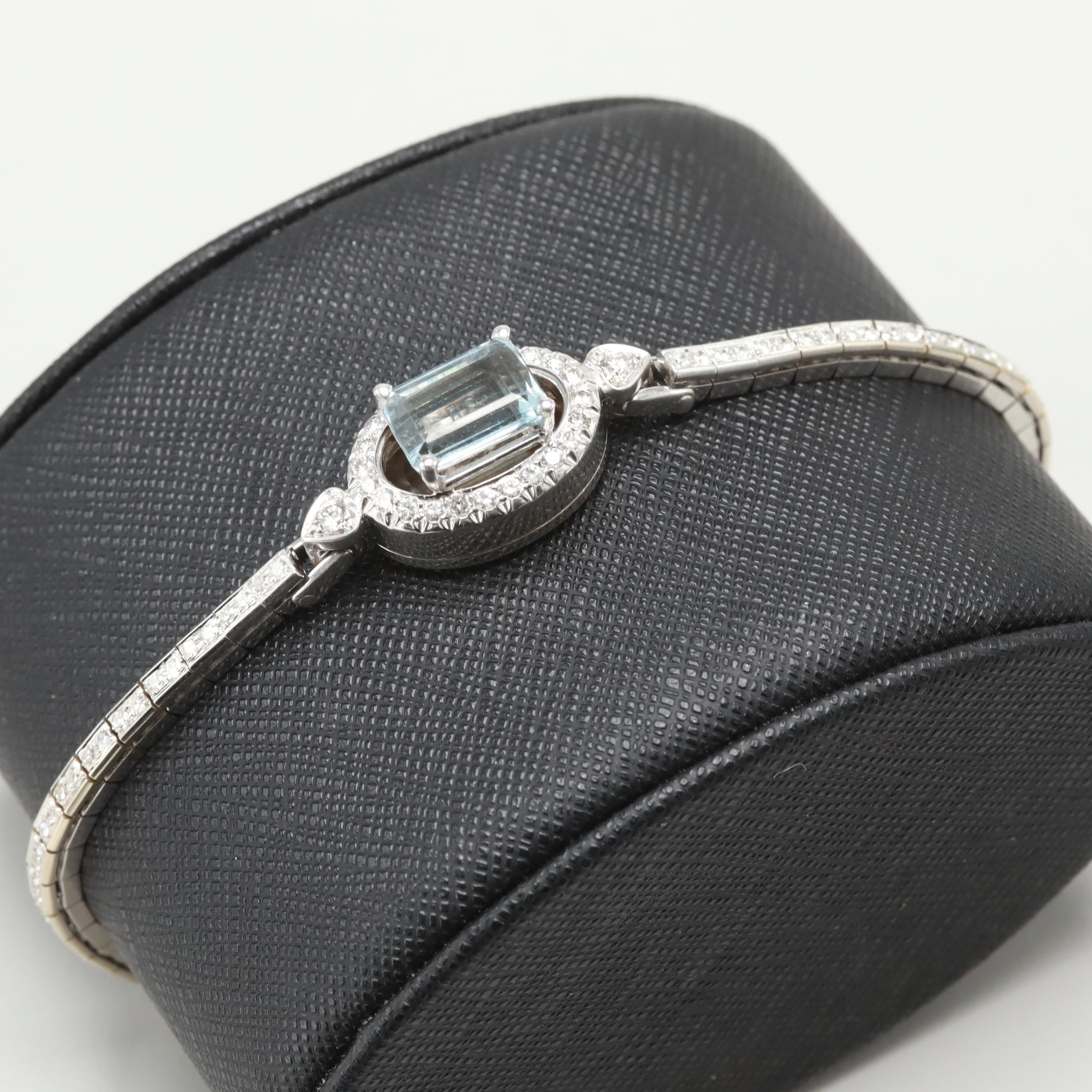 14K White Gold Blue Topaz and 1.08 CTW Diamond Bracelet