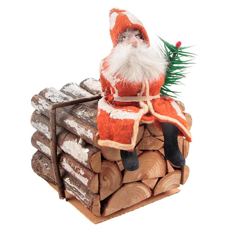 Antique German Candy Container with Belsnickle Santa Atop Stack Of Logs