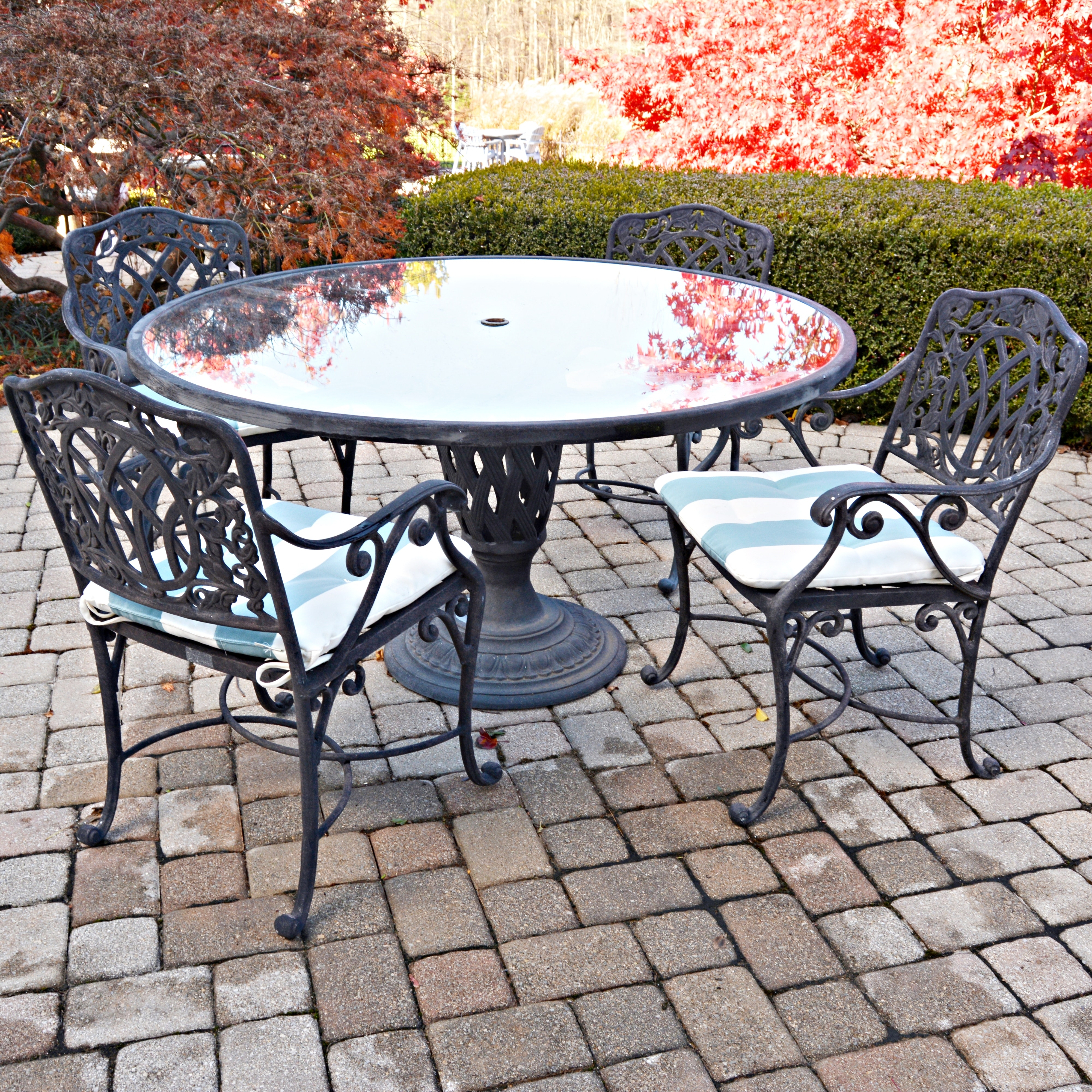 Cast Iron Patio Table, Chairs, and Umbrella