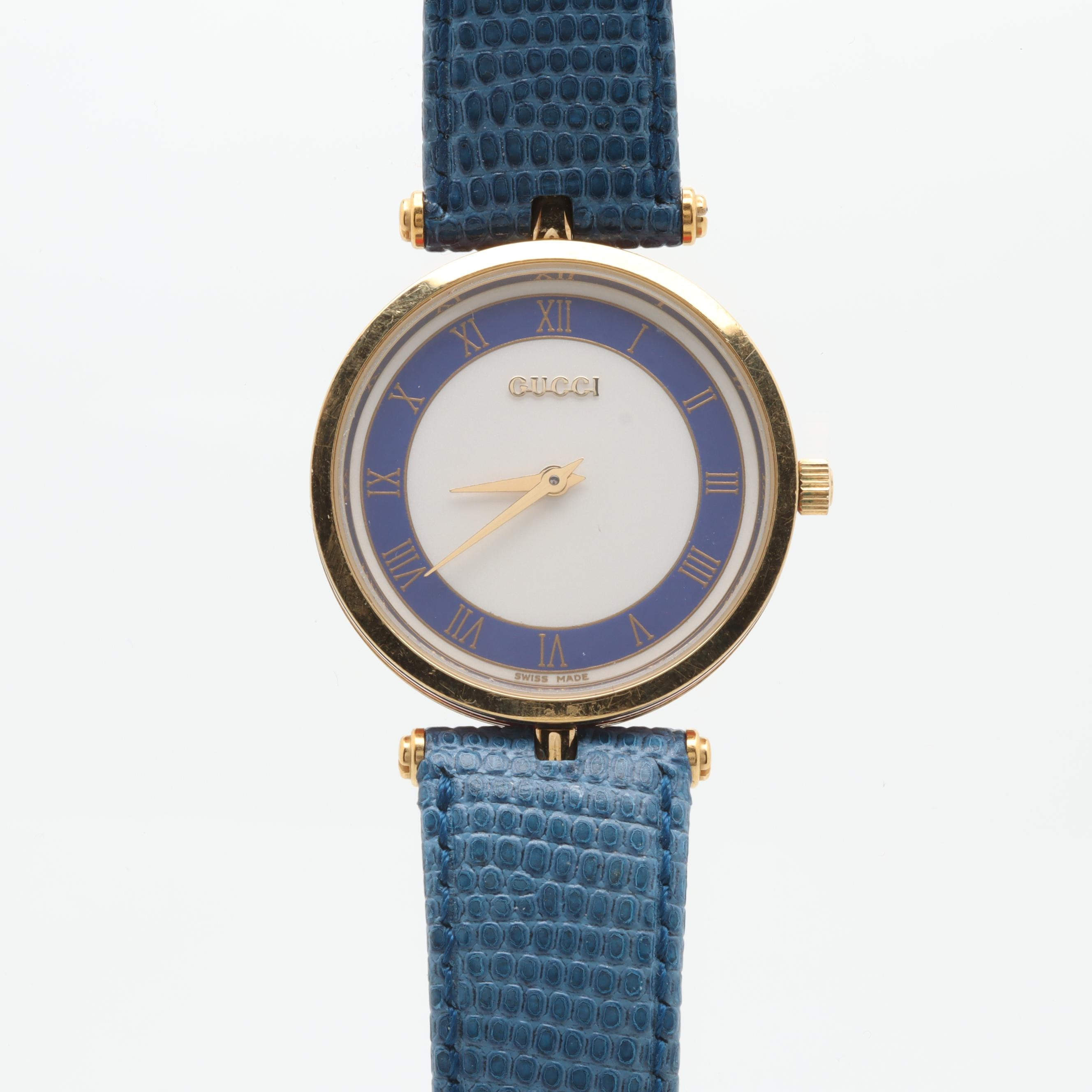 Gucci Gold Tone Wristwatch With Red and Blue Enameling