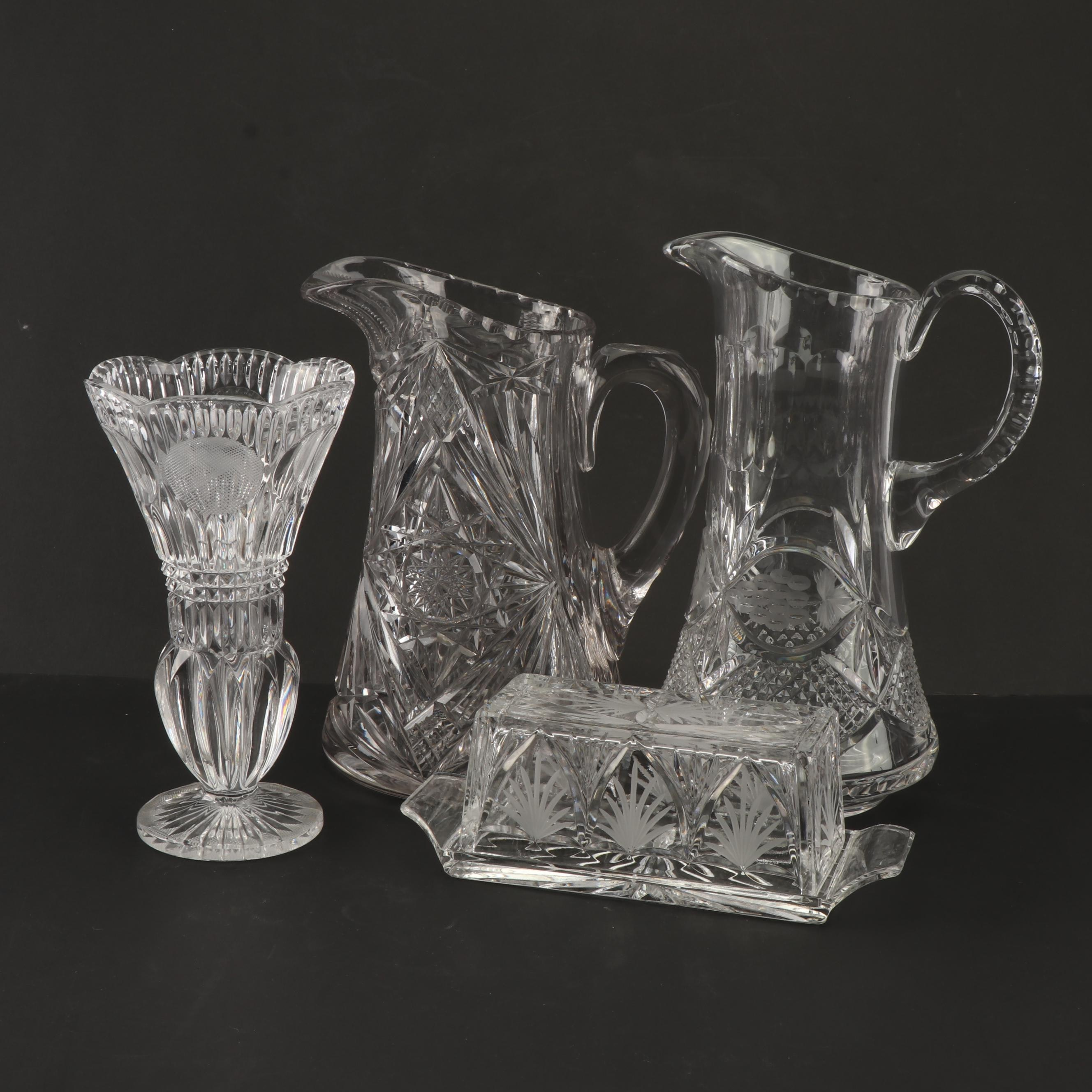 cut glass and crystal water pitchers, butter dish, and vase : ebth