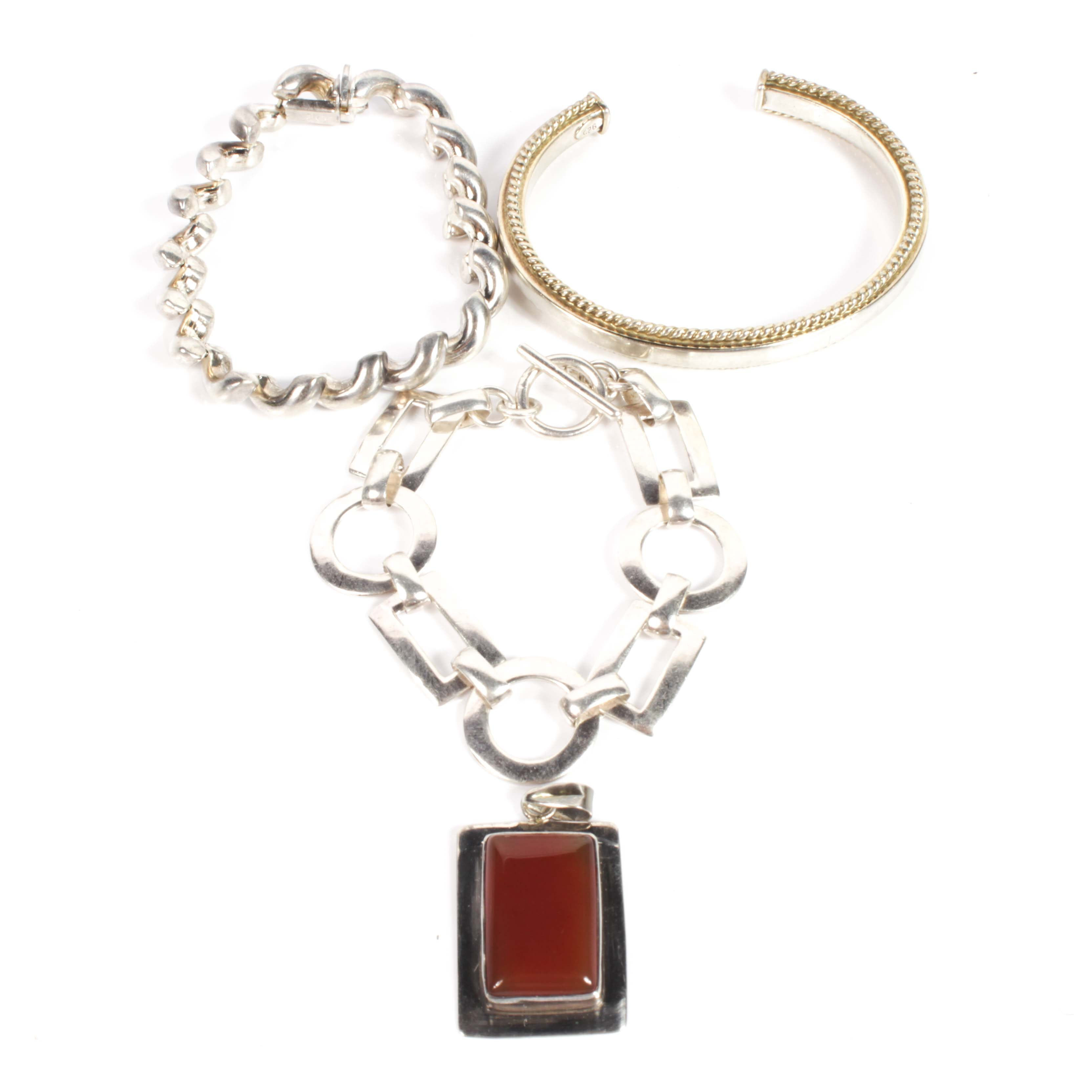 Sterling Silver and Carnelian Pendant and Three Sterling Silver Bracelets