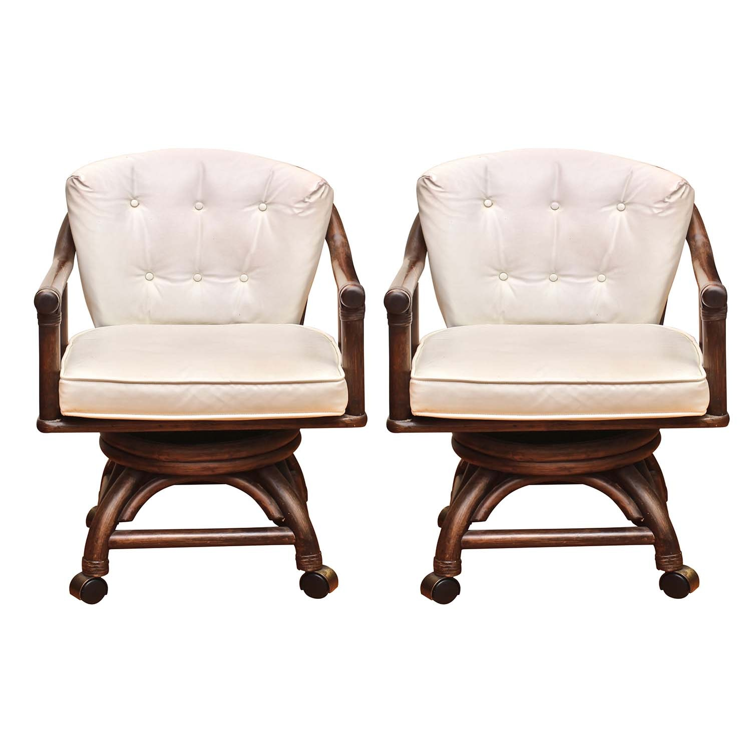 Two Rattan Specialties Mid Century Spring and Swivel Arm Chairs