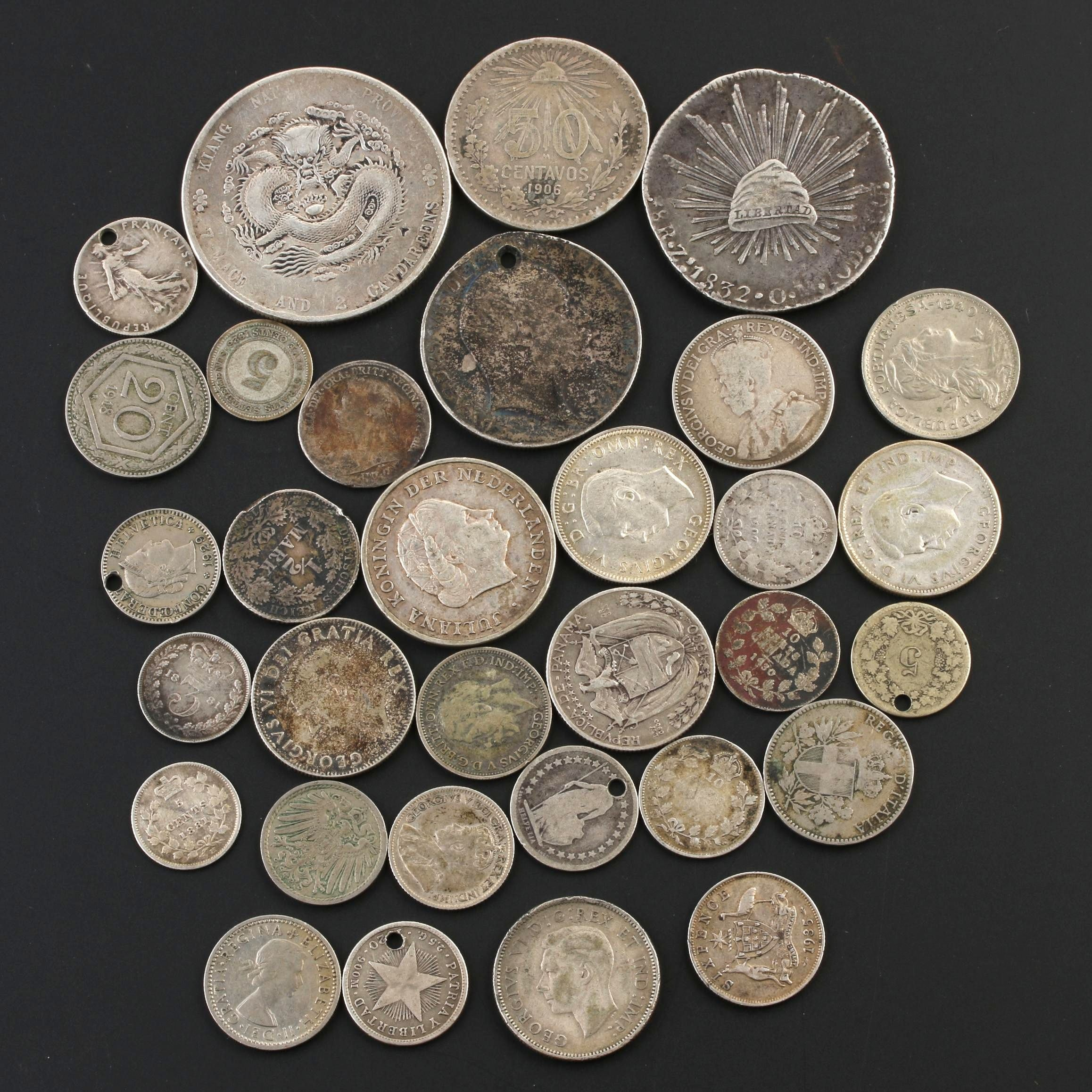 Assortment of Thirty-Two Antique to Vintage Silver Foreign Coins