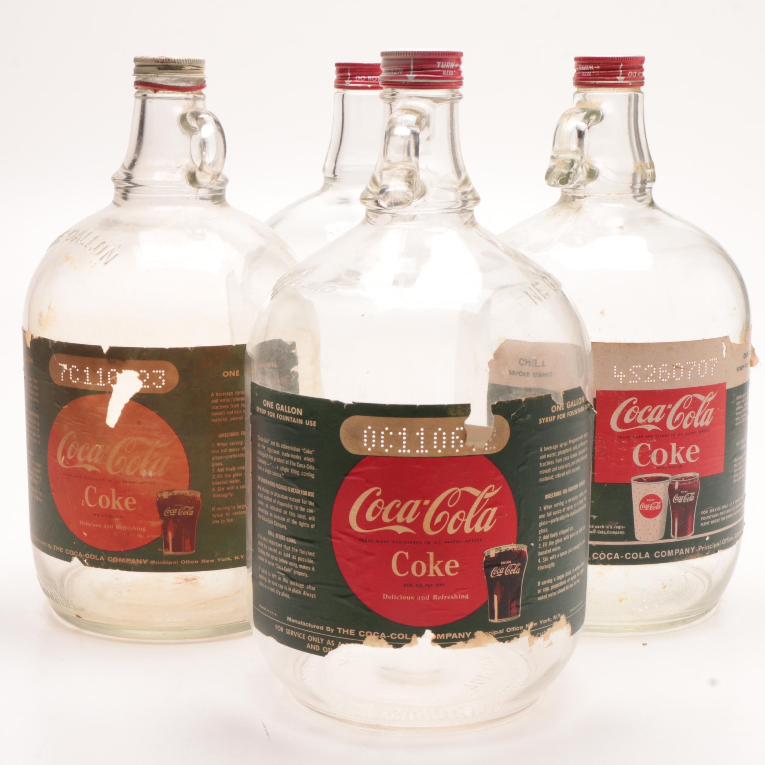 Four Coca-Cola Gallon Glass Syrup Bottles