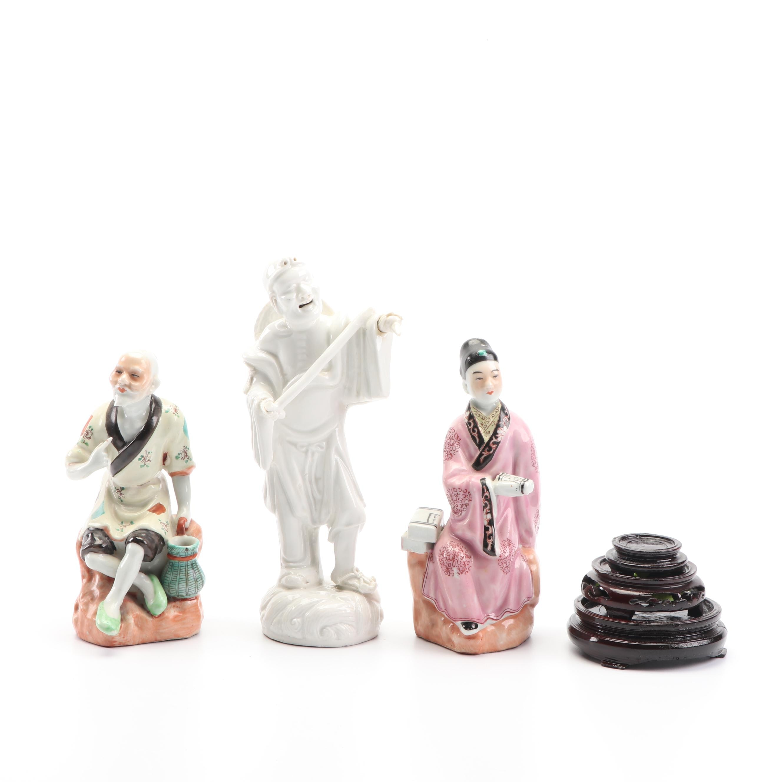 Chinese Ceramic Figurines with Carved Wood Stands