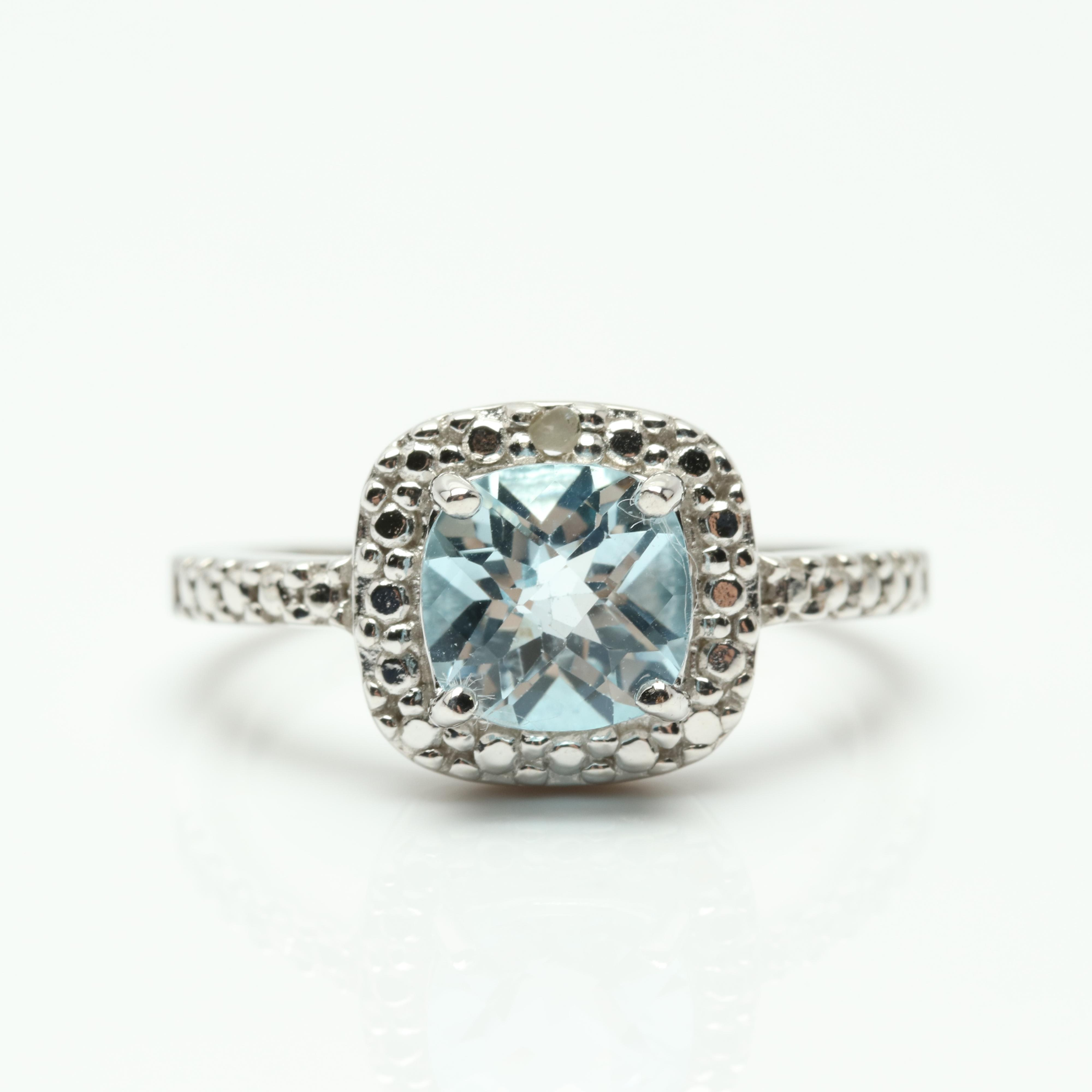 Sterling Silver 1.75 CT Blue Topaz and Diamond Ring