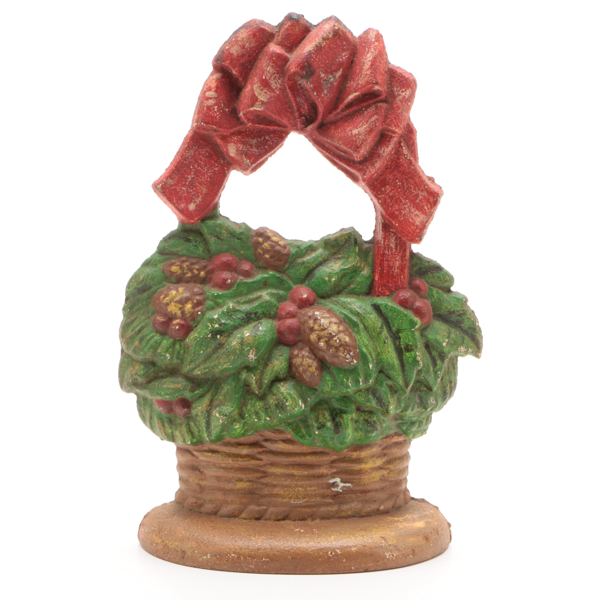 John Wright Painted Cast Iron Christmas Flower Basket Doorstop, Late 20th C.