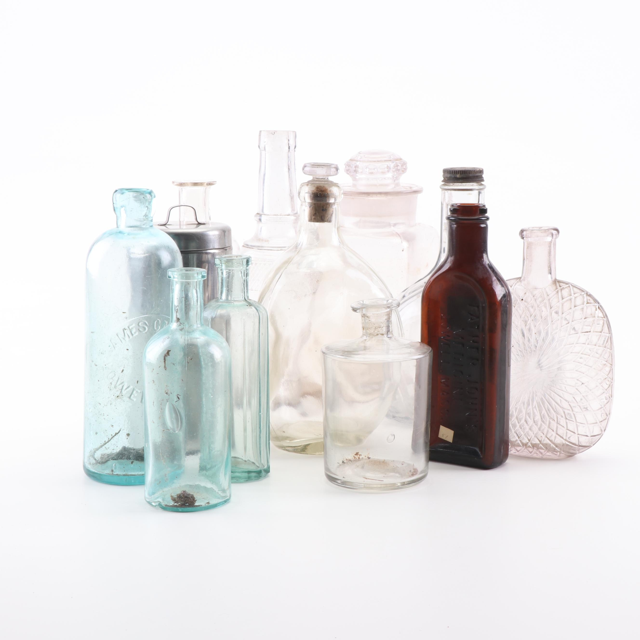 Vintage Glass Bottles, including Dr. S.A. Tuttle, Father John's and Others