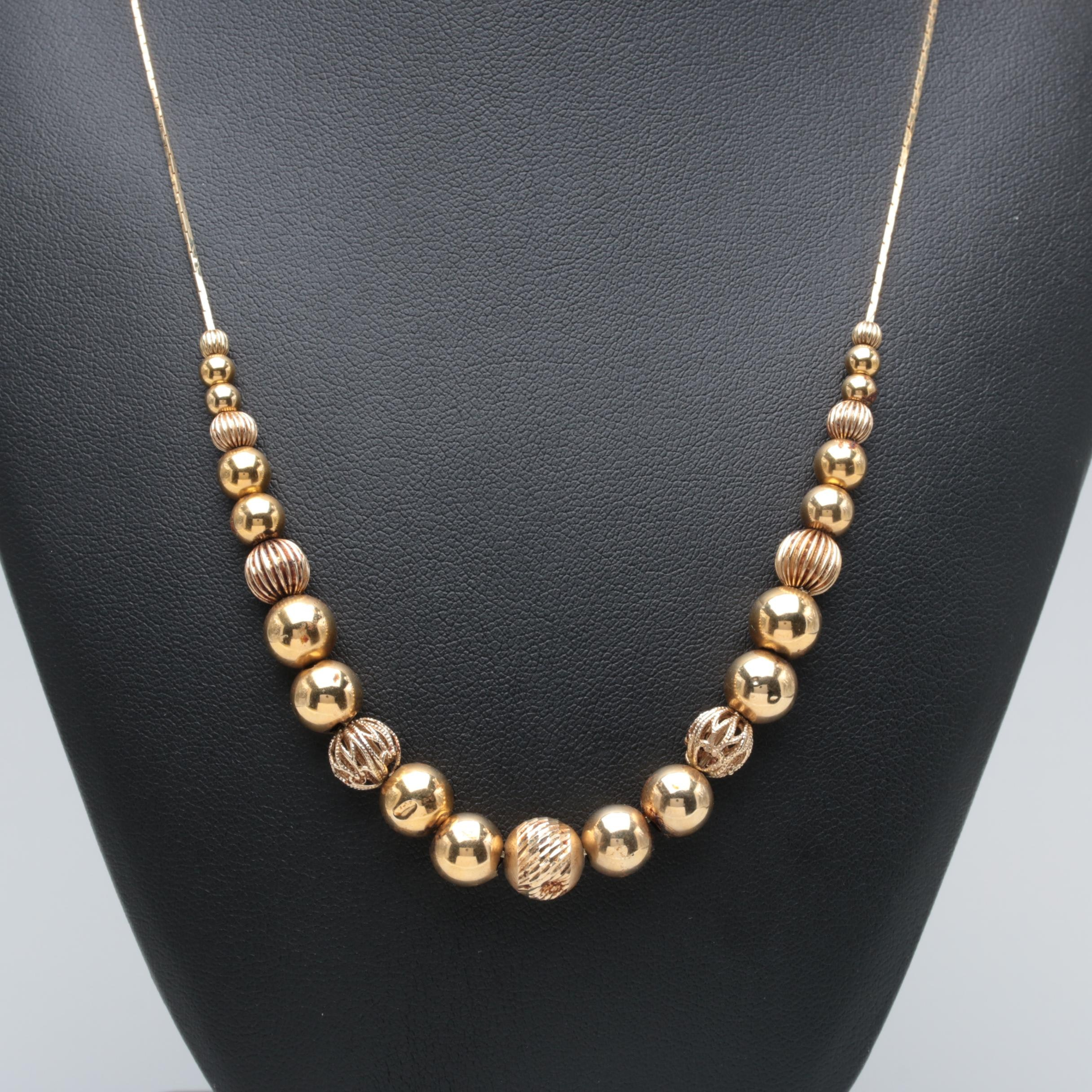 14K Yellow Gold Graduating Textured, Pierced, and High Polish Bead Necklace