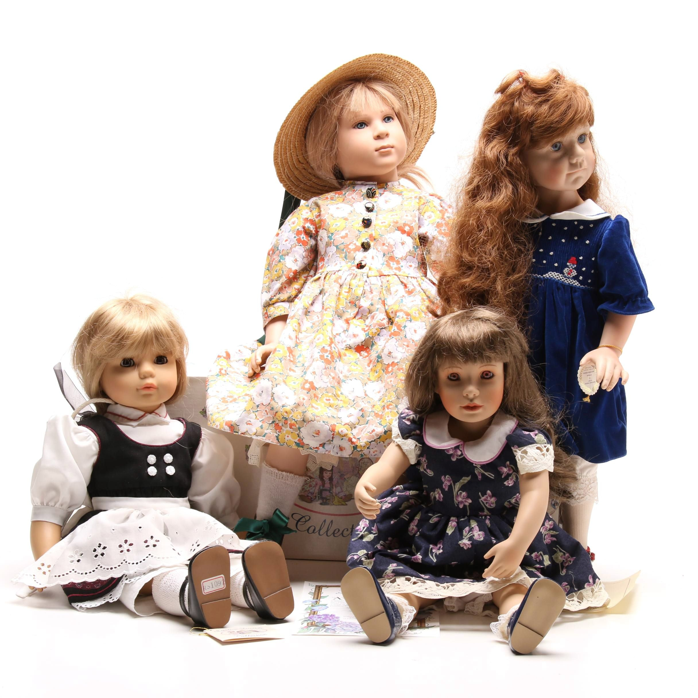 "Four 18"" to 24"" Dolls"