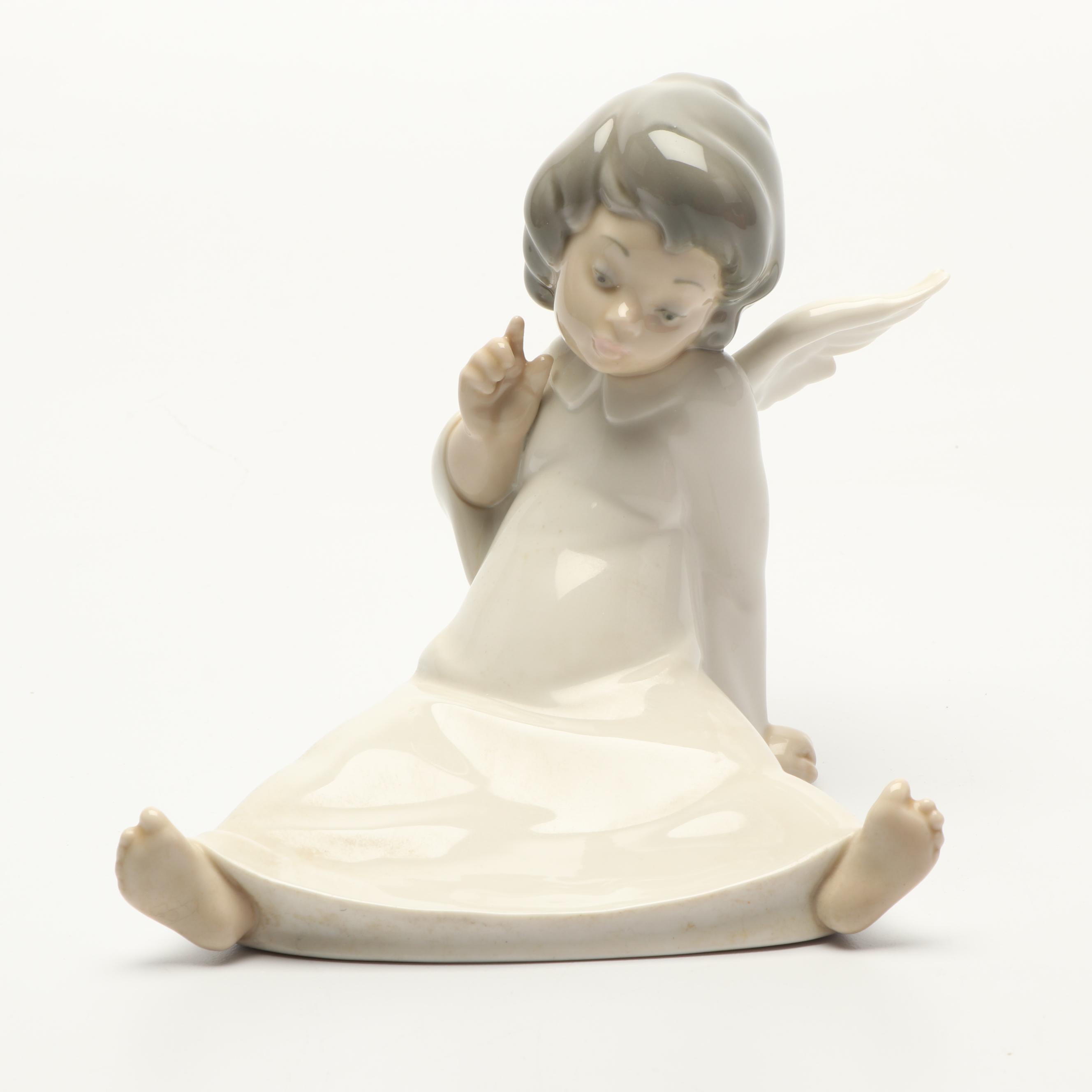 "Lladró ""Angel Wondering"" Porcelain Figurine"
