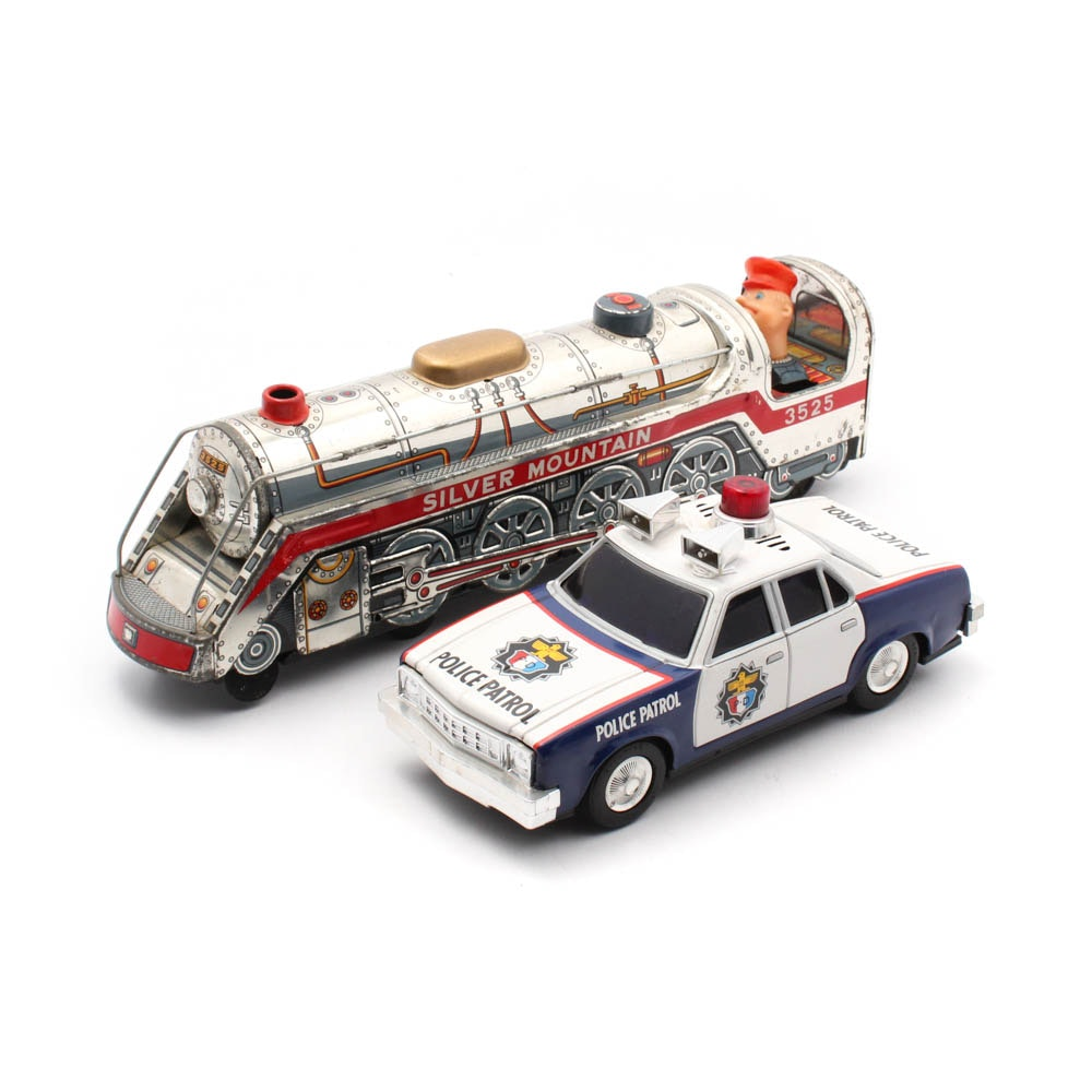 Vintage Tin Locomotive and Police Care