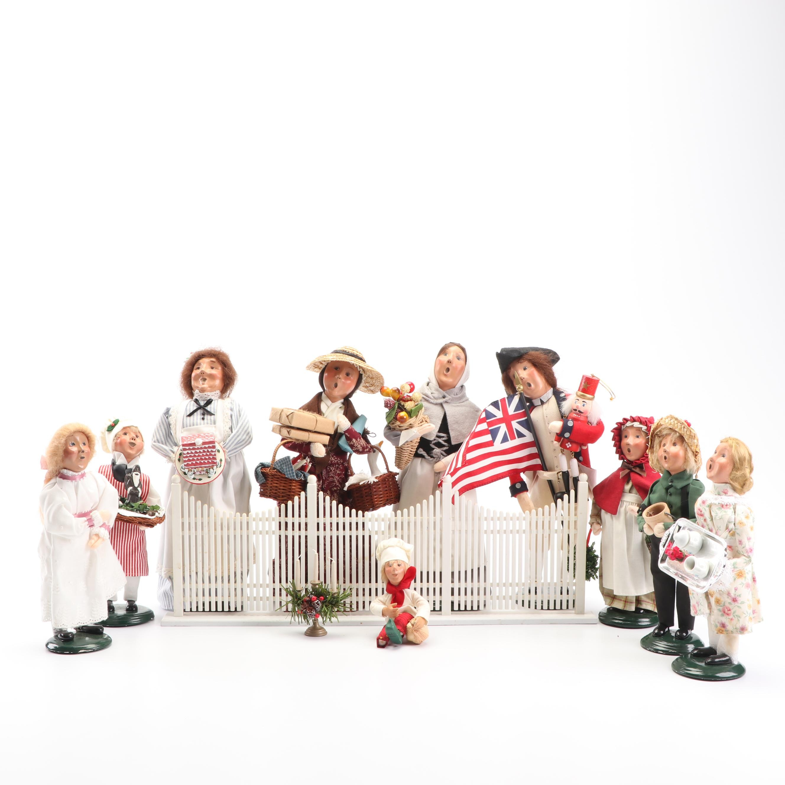 Byers' Choice Carolers and Fence Featuring Signed Caroler and First Edition