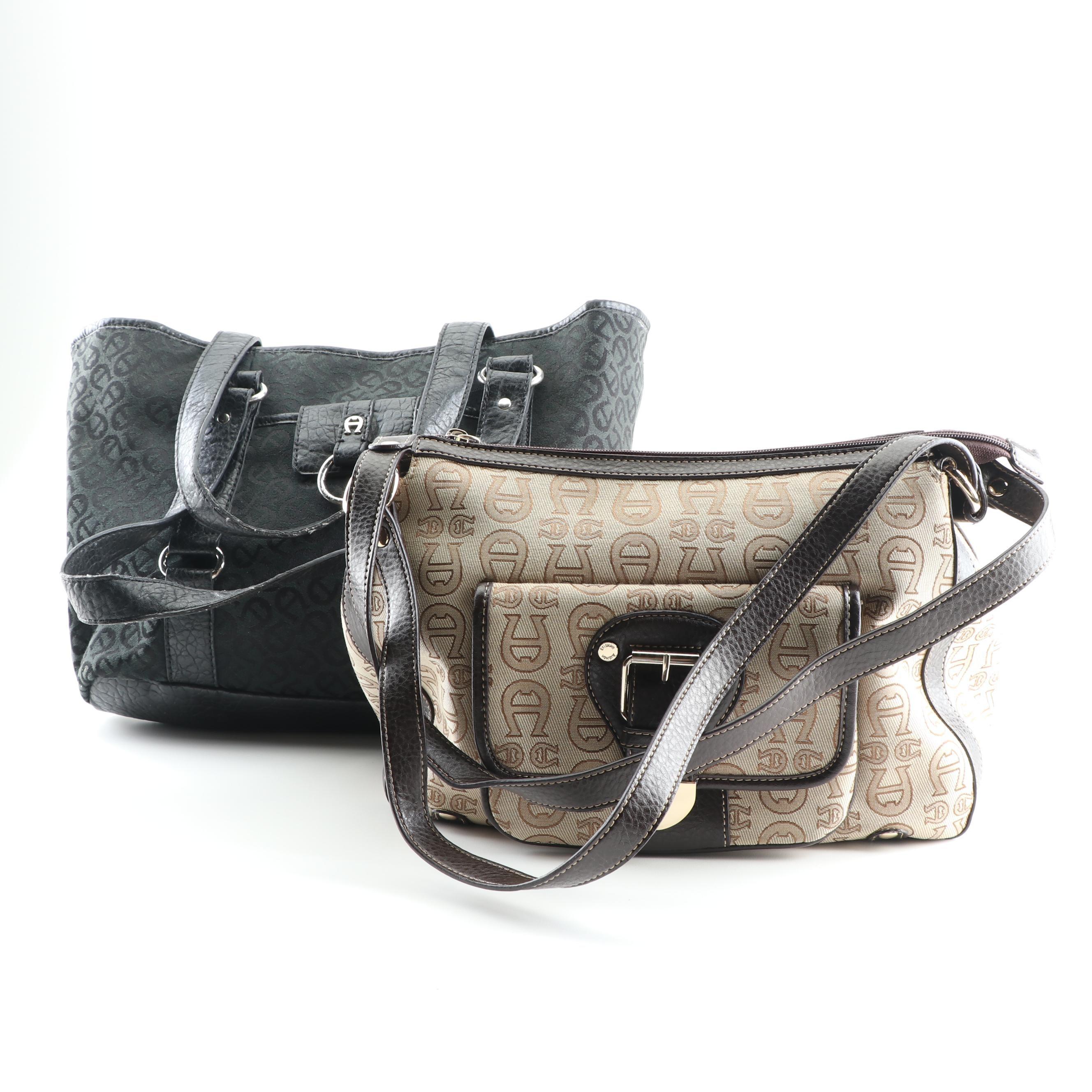 Etienne Aigner Black and Tan Canvas Signature Print Shoulder Bags