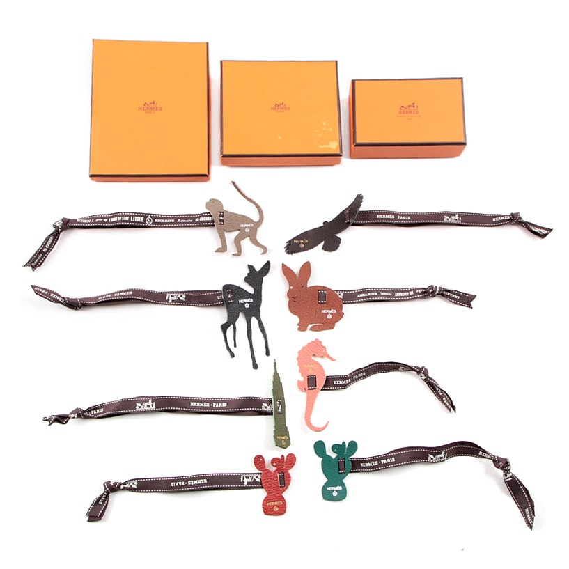 Collection Of Hermès Leather Charms On Ribbons