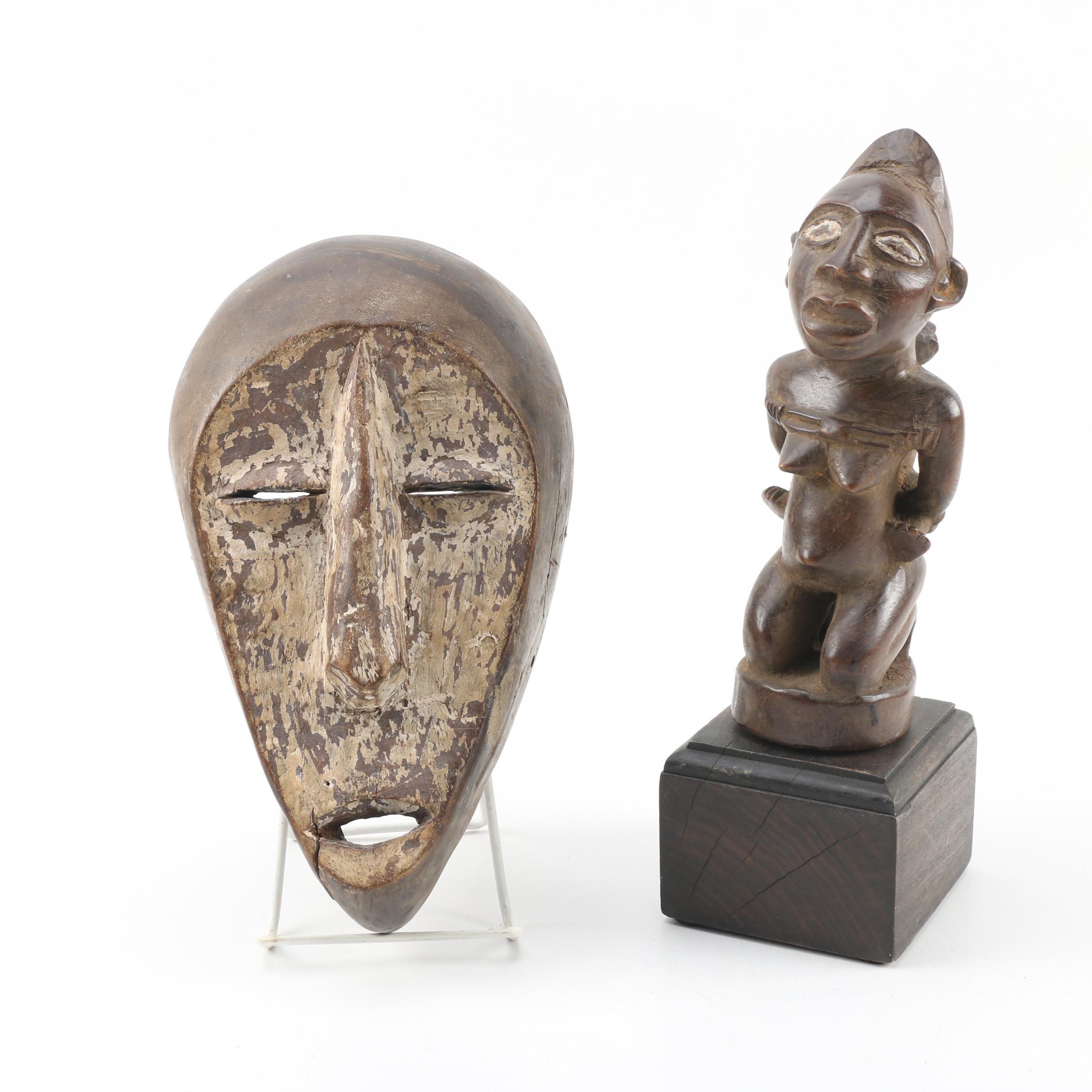 Carved Wood Lega Bwami Style Mask and Yoruba Figure