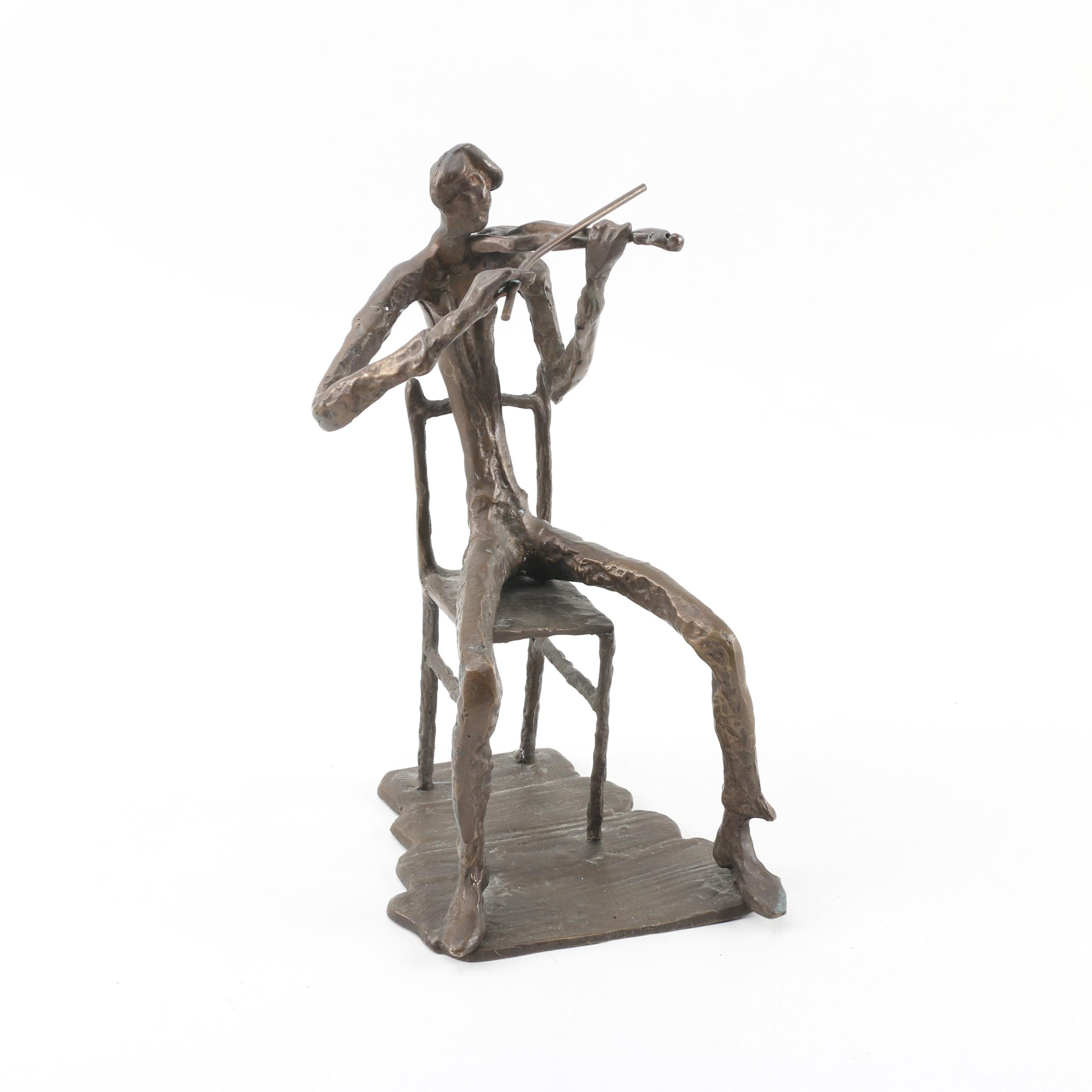 Metal Sculpture of a Violin Player