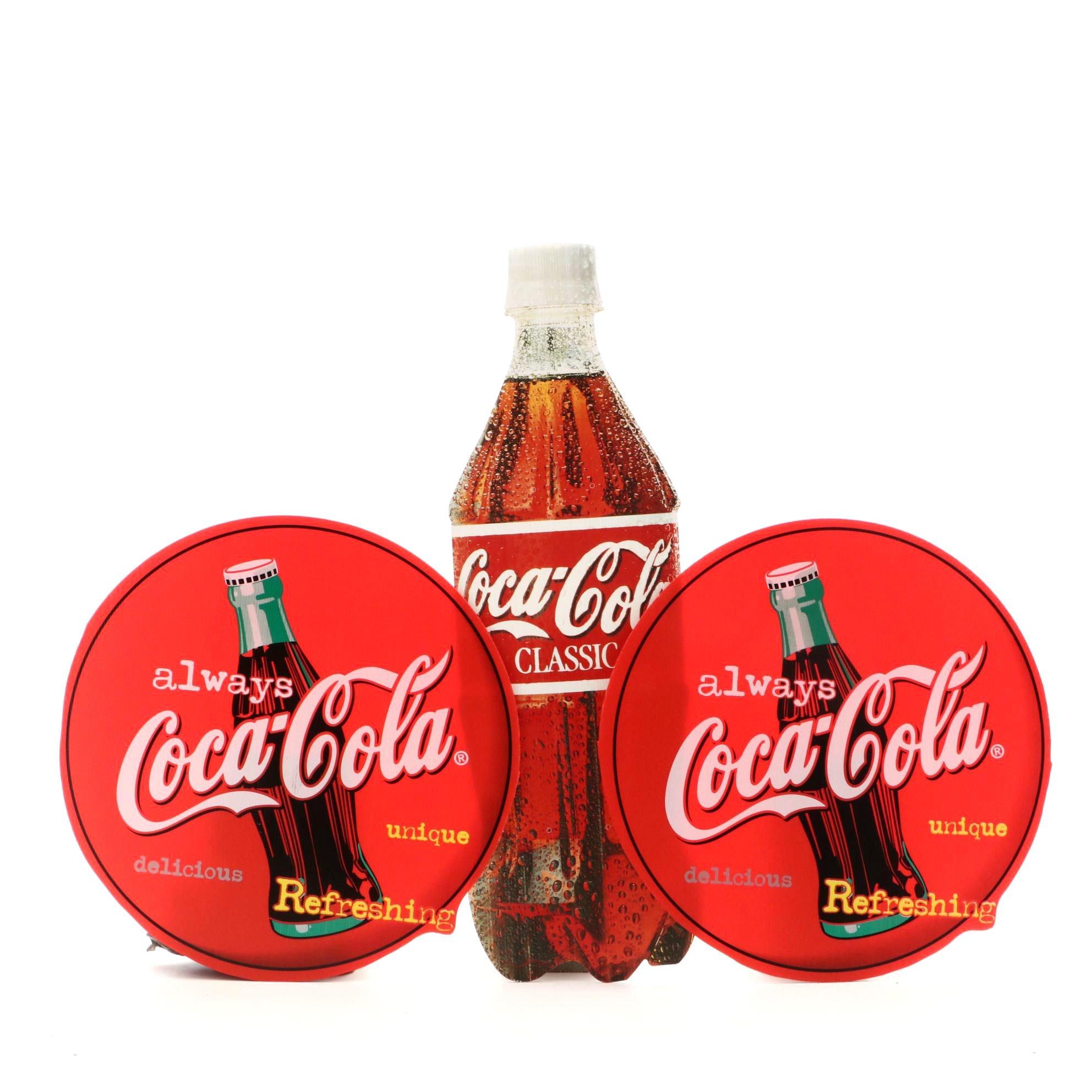 Three Coca-Cola Advertising Signs
