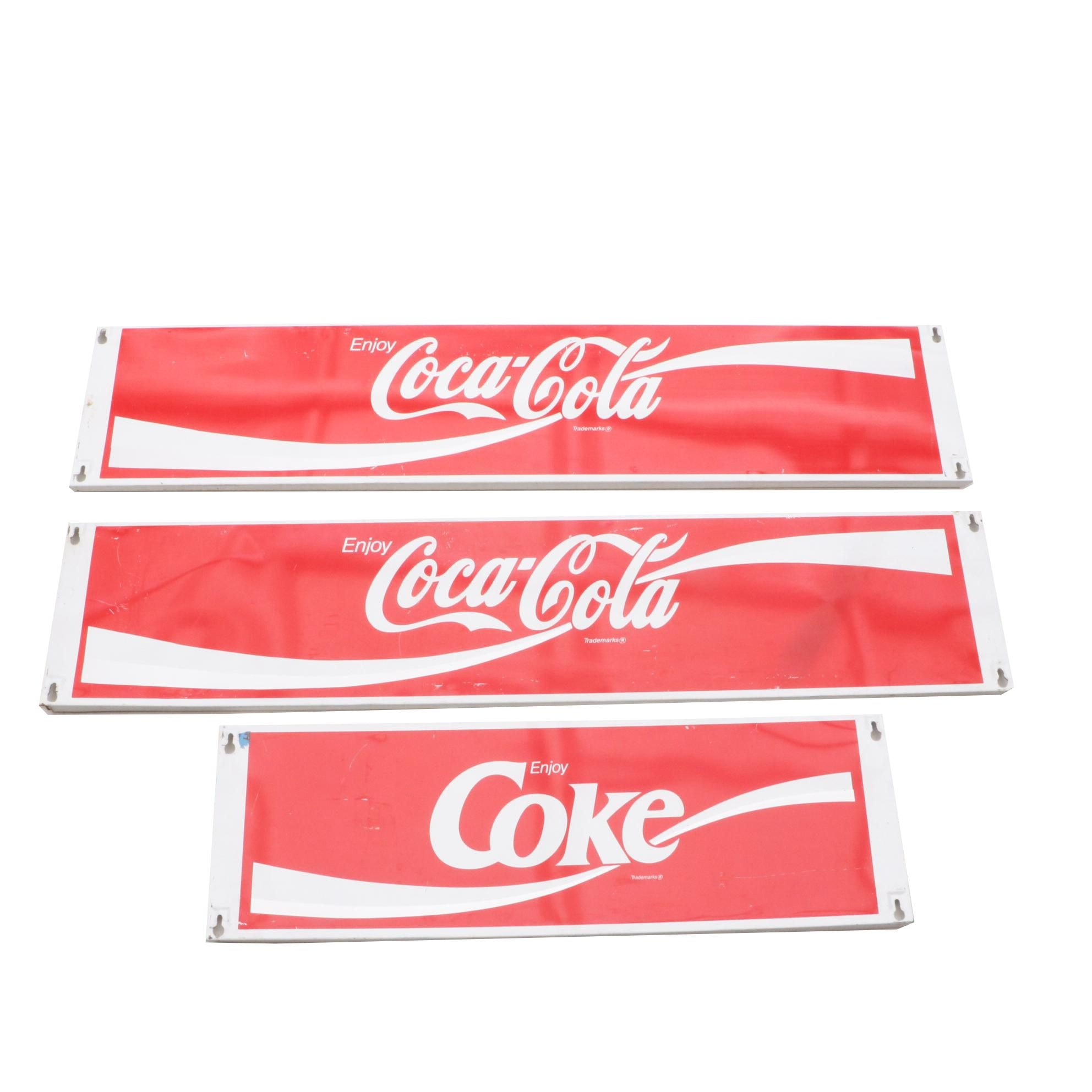Three Metal Coca-Cola Wall Signs