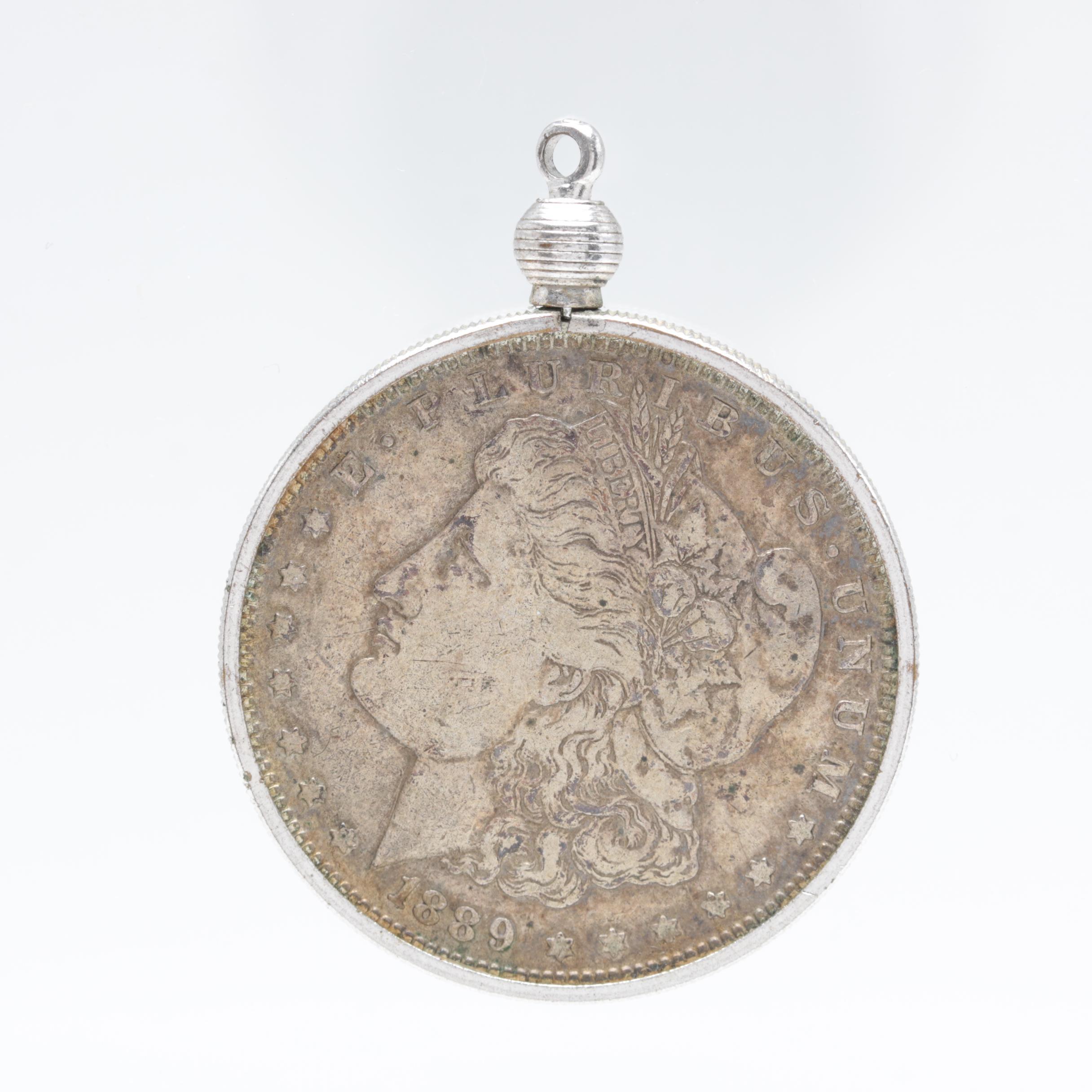 Silver Tone Bezel Pendant Holding an 1889-O Morgan Silver Dollar