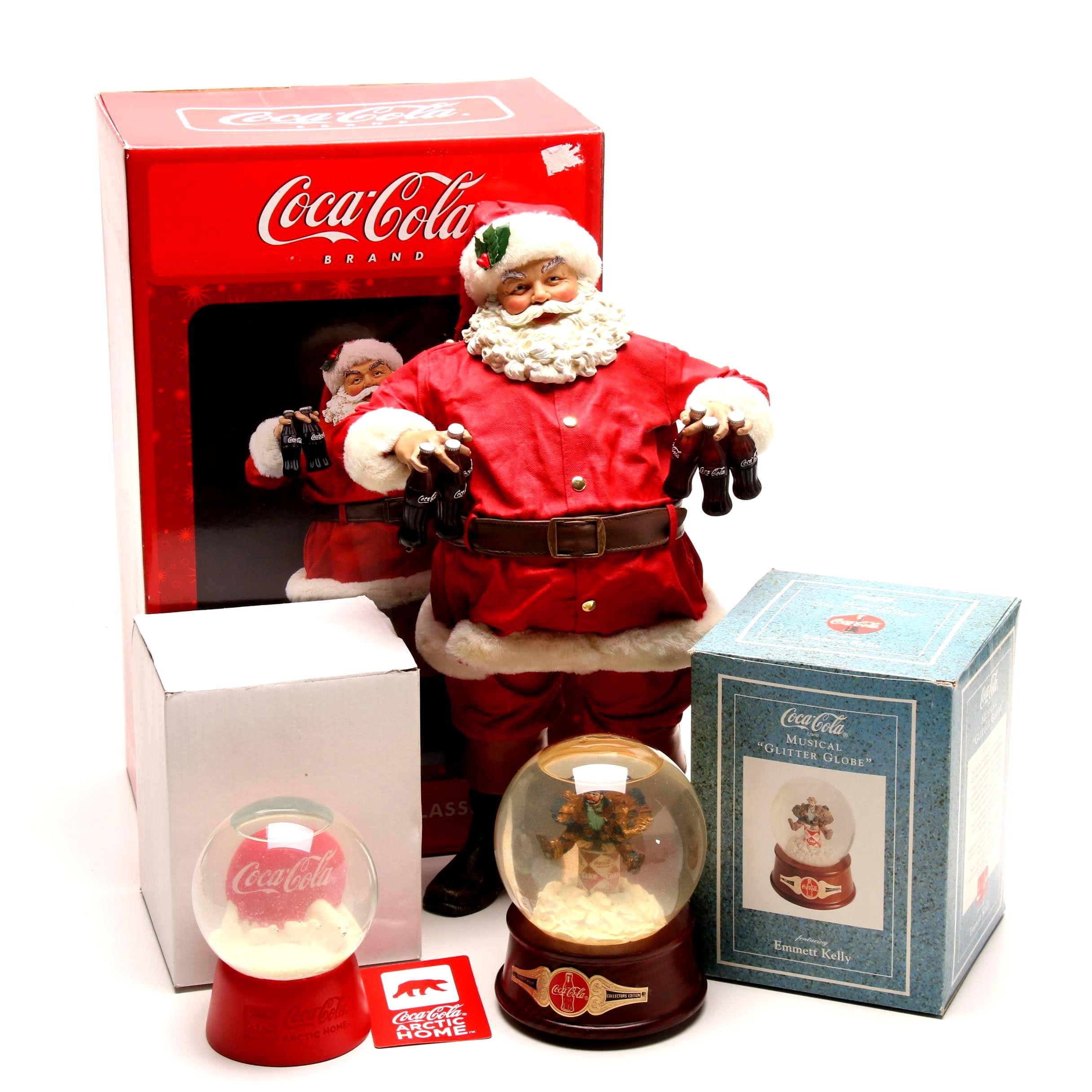 Coca-Cola Snow Globes and Santa Figurine