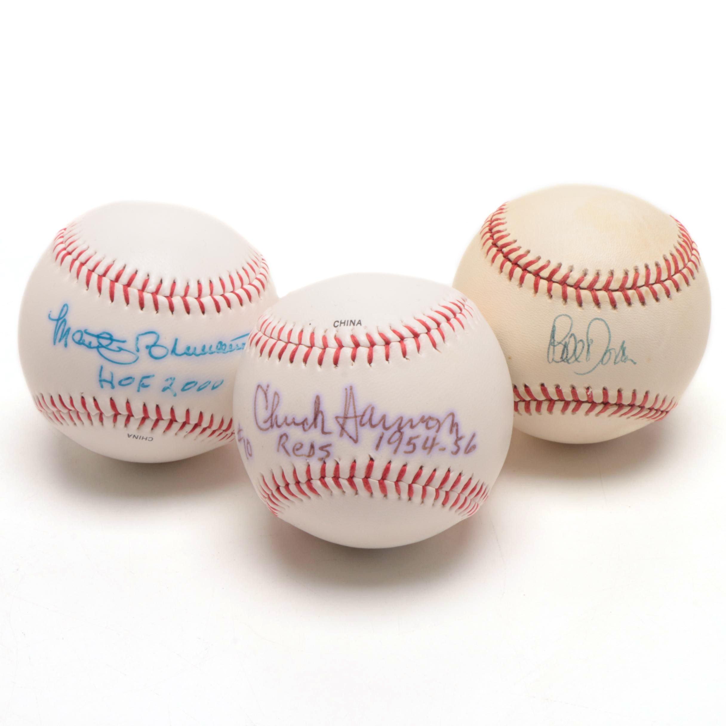 Marty Brennaman, Chuck Harmon, and Bill Doran Signed Baseballs