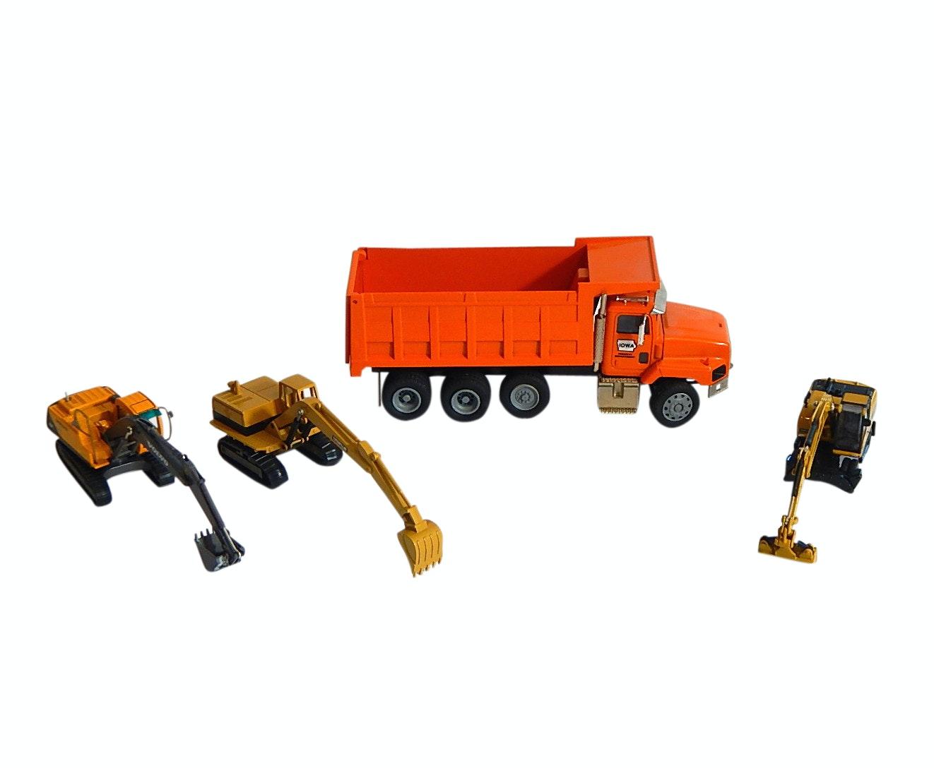 Die Cast Iowa Highway Dept. Dump Truck and Three Excavators with Volvo