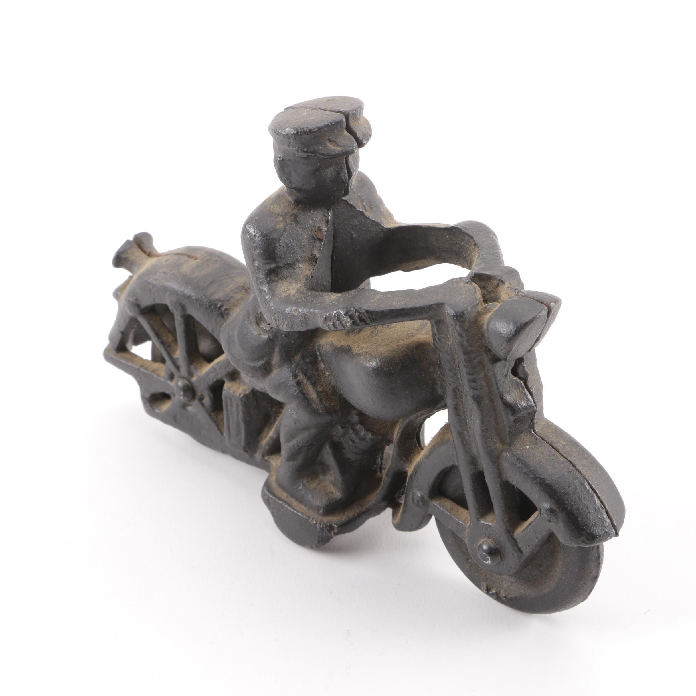 Vintage Cast Iron Motorcyclist Figurine
