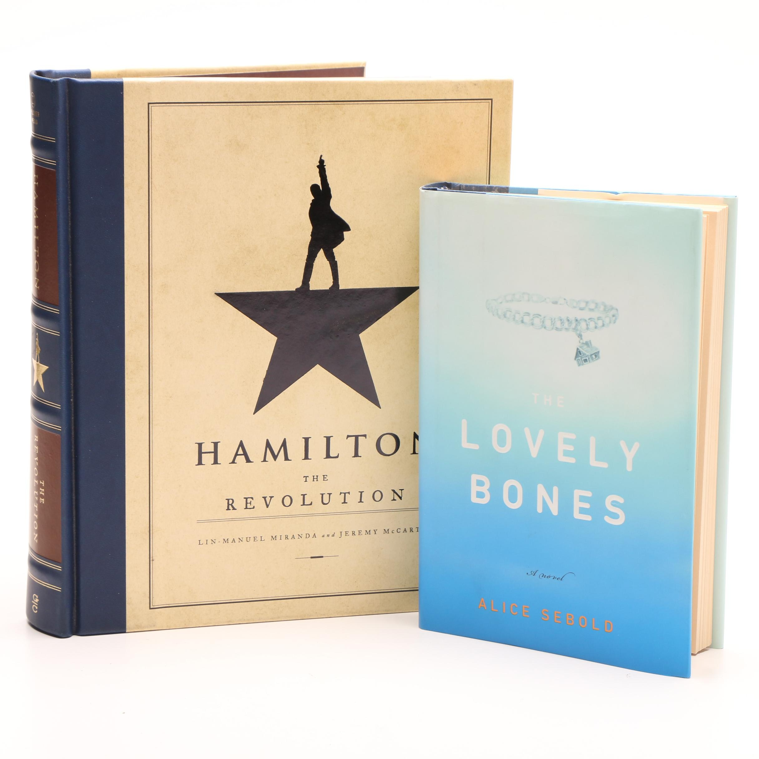 """The Lovely Bones,"" and ""Hamilton The Revolution"" Hardbound Books"