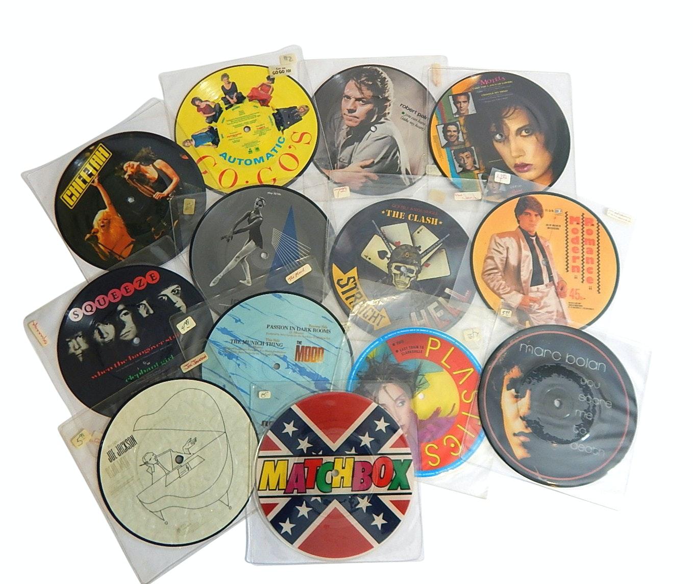 "Vintage 7"" Vinyl Picture Discs with Rock and Pop Genre - 13 Count Lot"