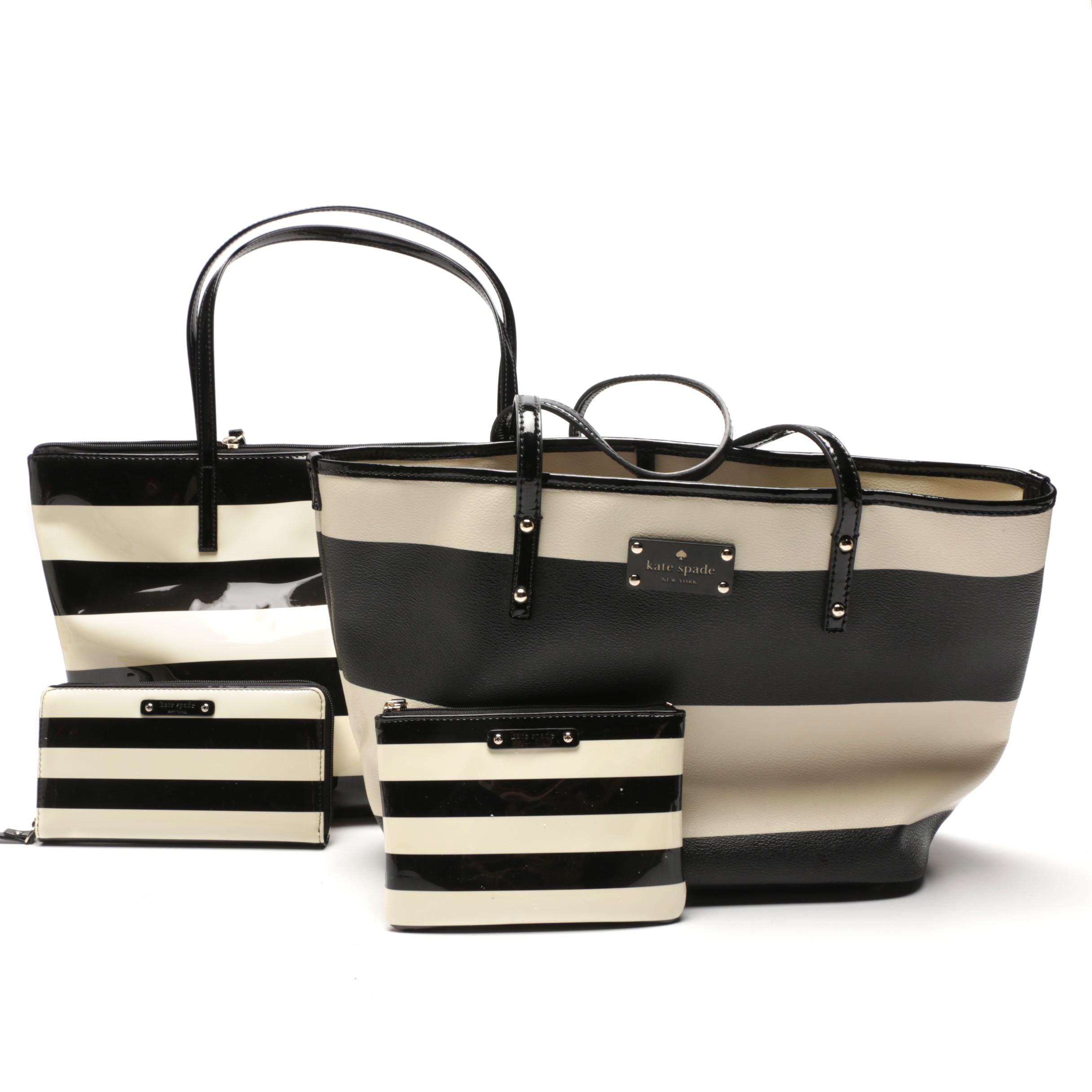Two Kate Spade New York Black and White Striped Leather Totes