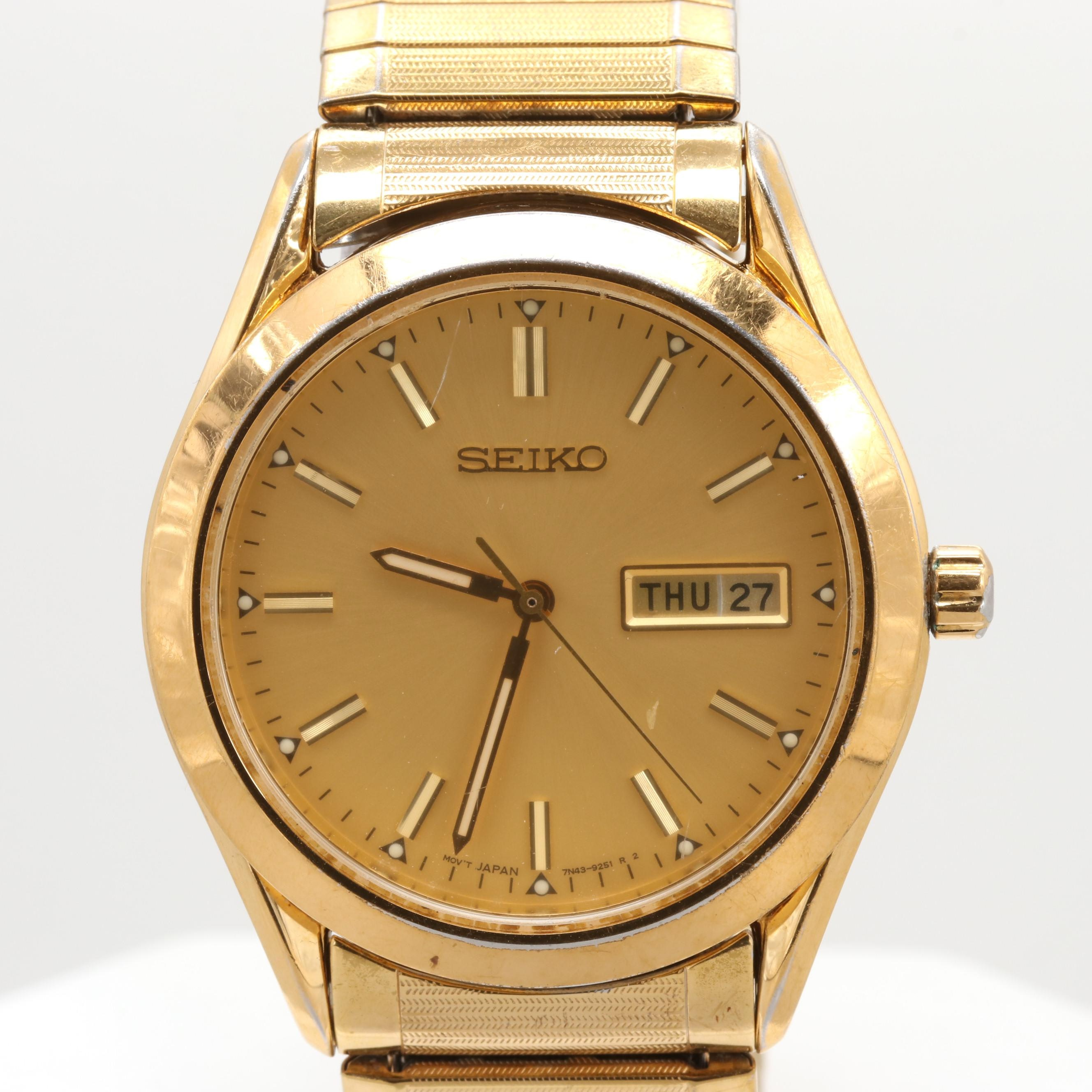 Seiko Gold-Tone Quartz Wristwatch With Day and Date Window