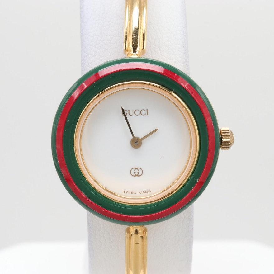 Gucci 1100-L Gold Tone Quartz Wristwatch With Interchangeable Bezels