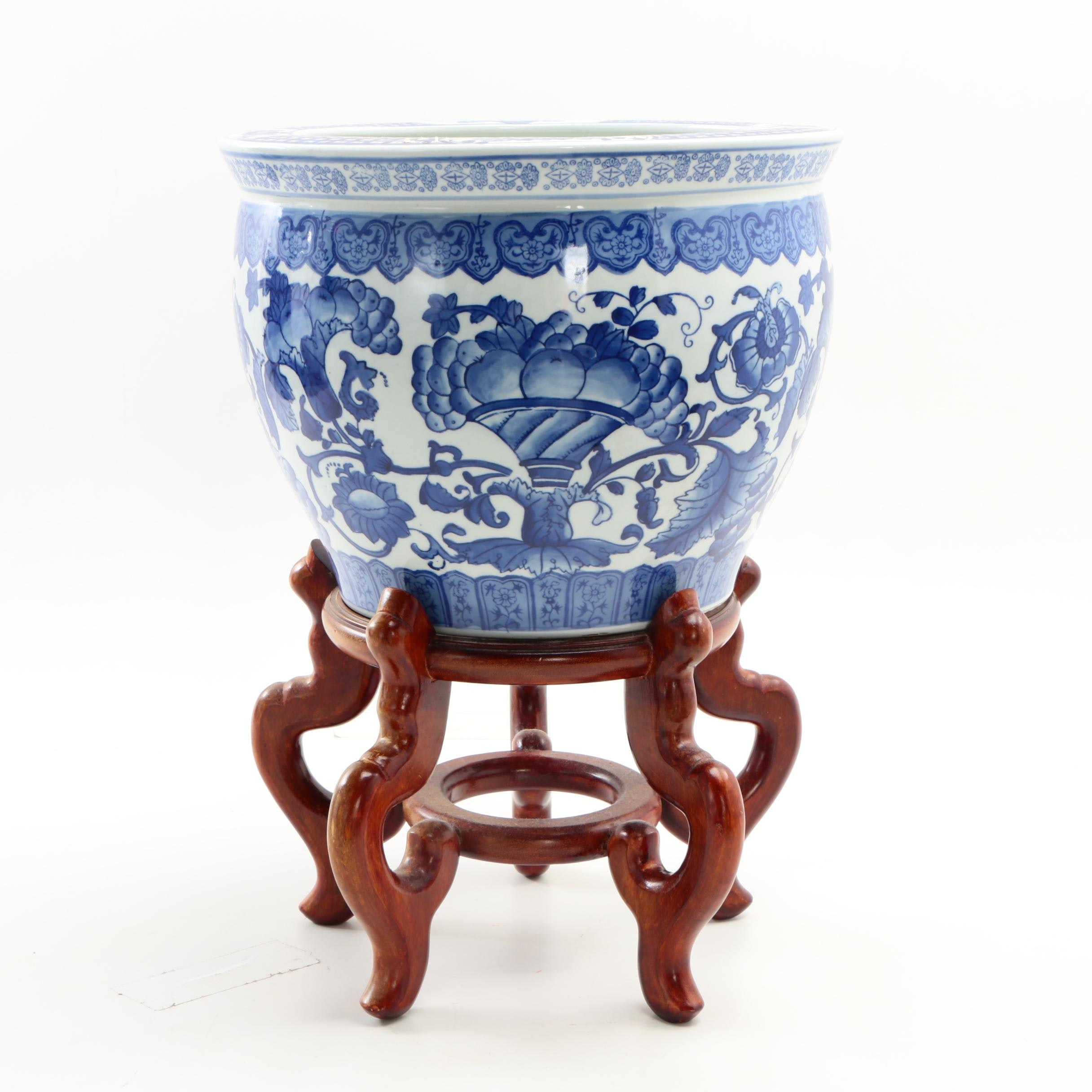 Chinese Blue and White Ceramic Fishbowl Jardiniere with Carved Wooden Stand