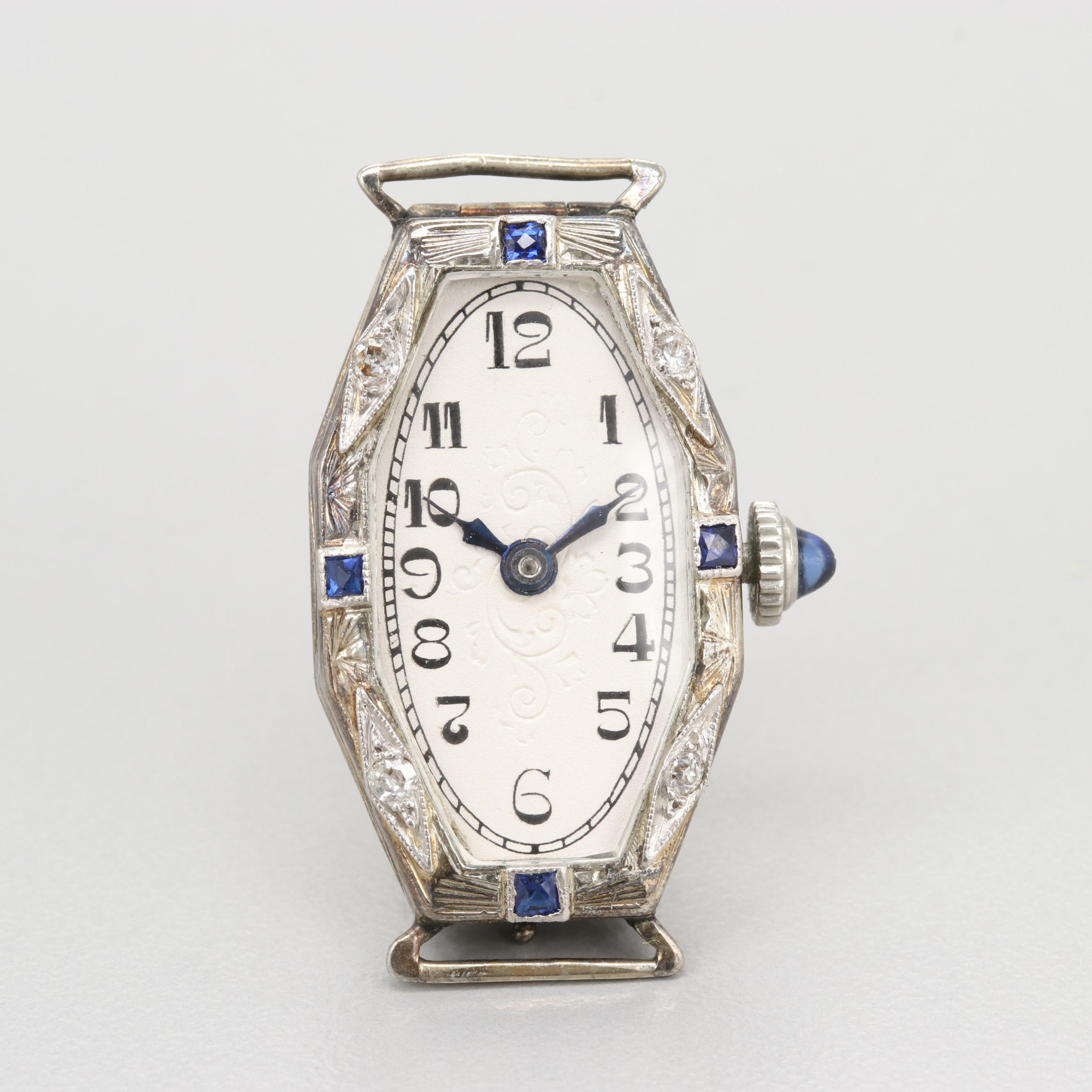 18K White Gold Watch With Platinum Trim Diamonds and Sapphires