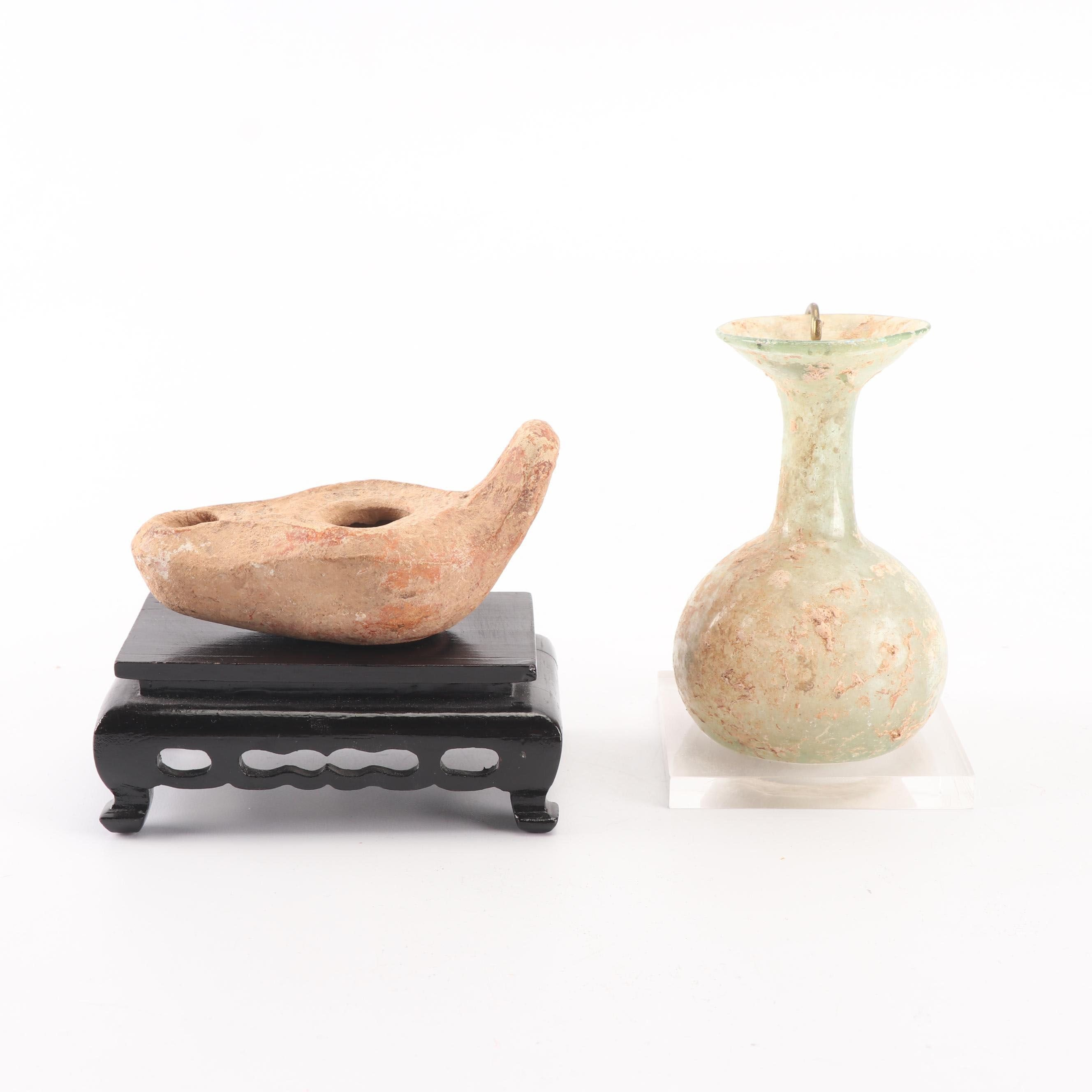 Decorative Earthenware Oil Lamp And Roman Style Glass Vase Ebth