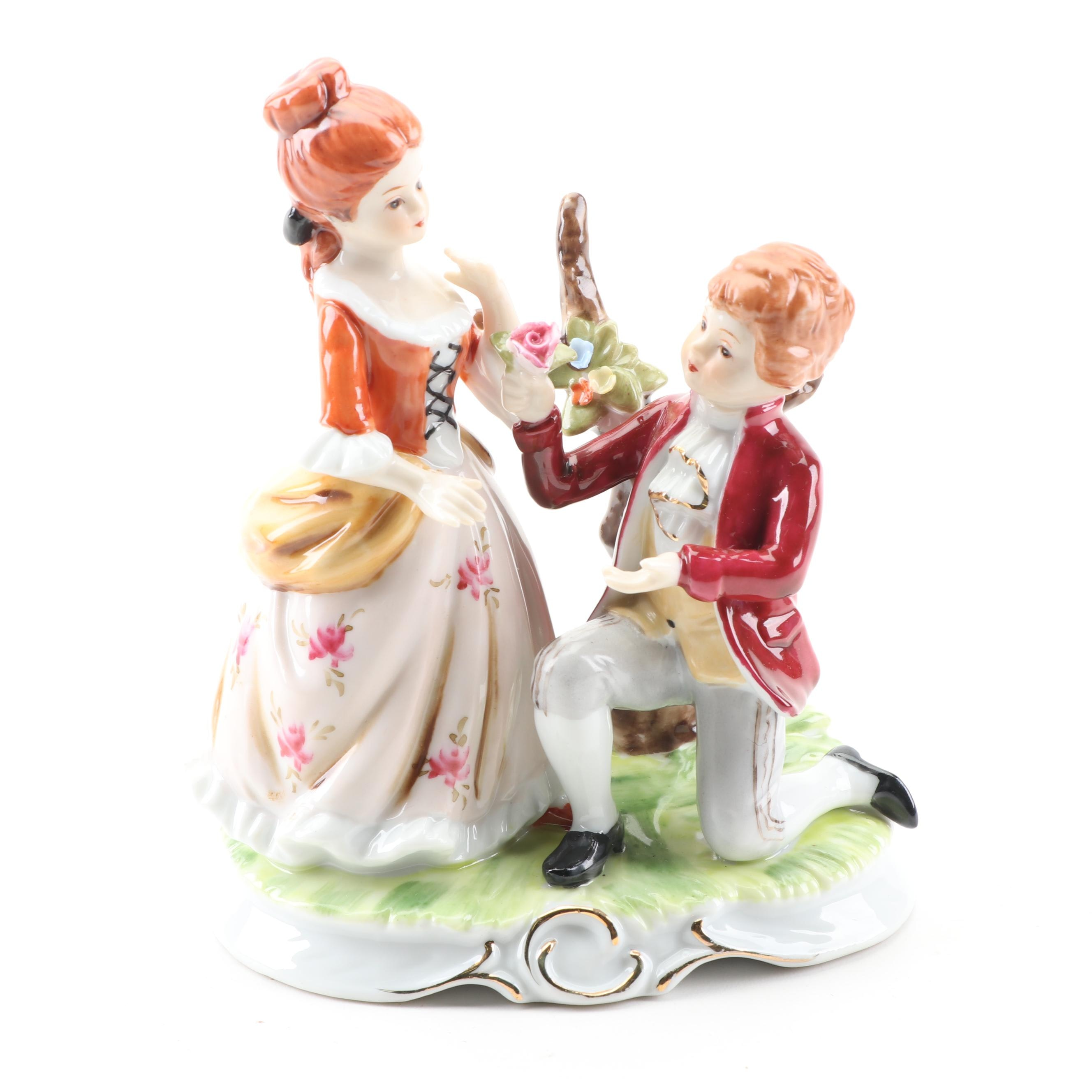 Hand-Painted Porcelain Figurine of Young Couple