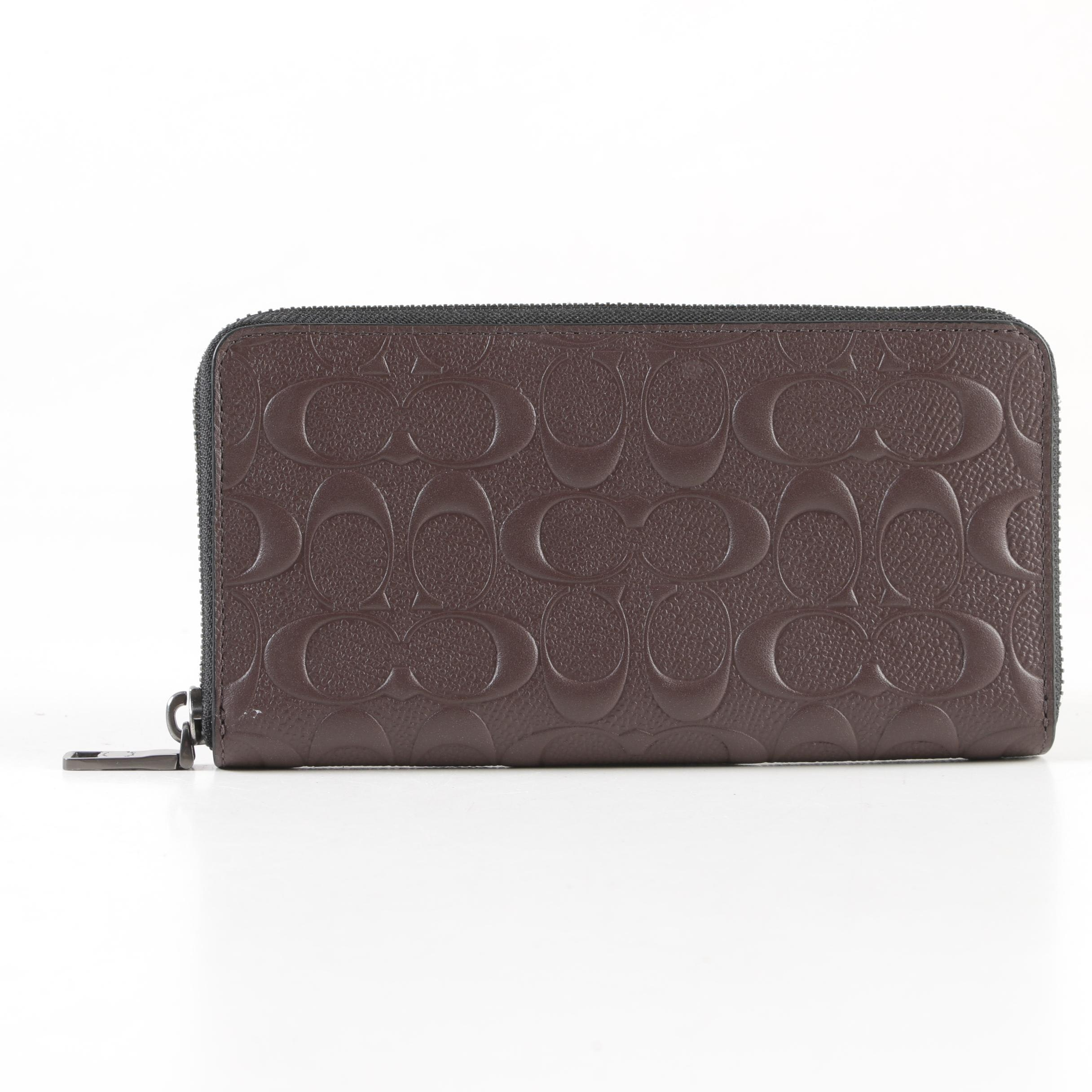 Coach Signature Embossed Brown Leather Zip Wallet