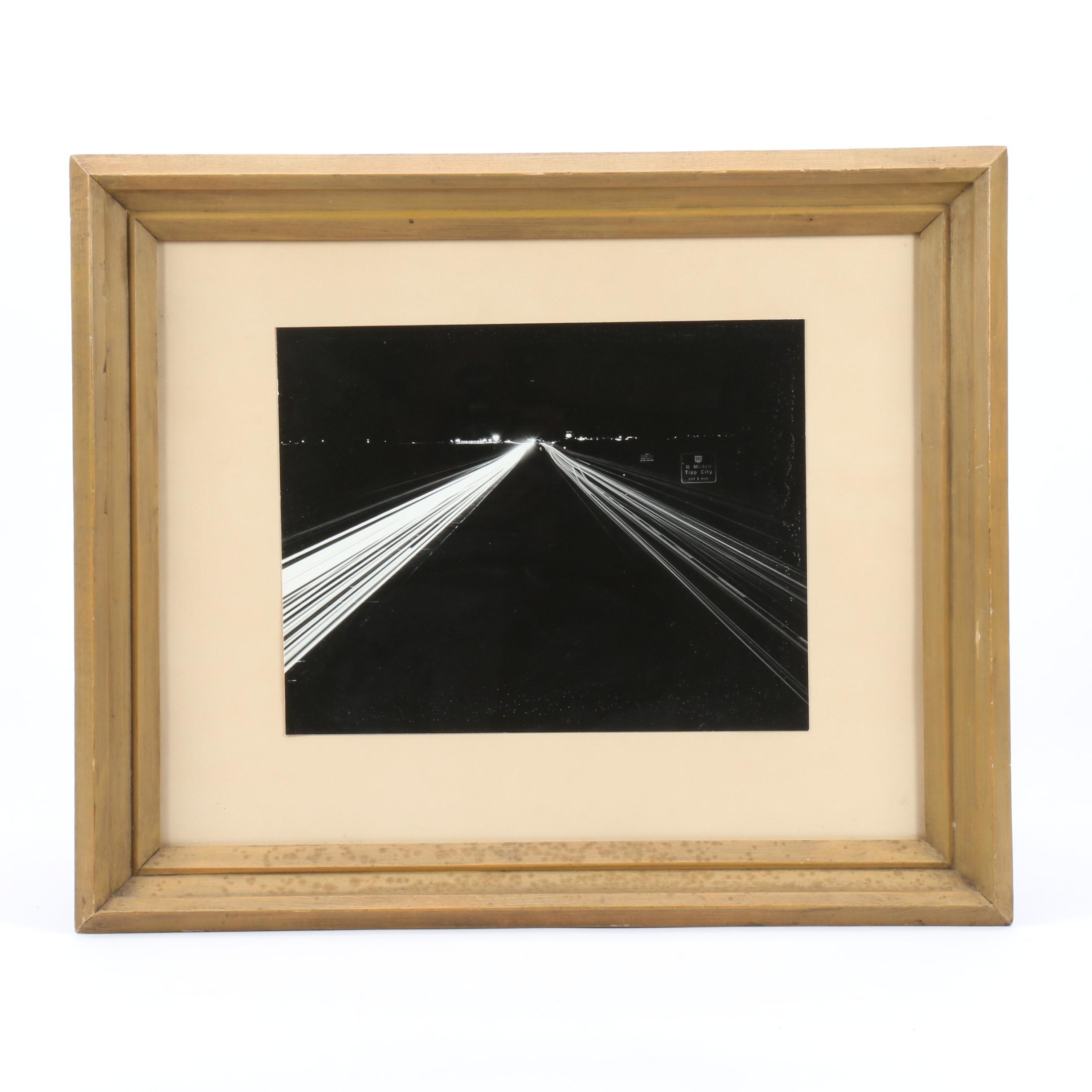 Black and White Photograph of Nocturnal Highway Scene