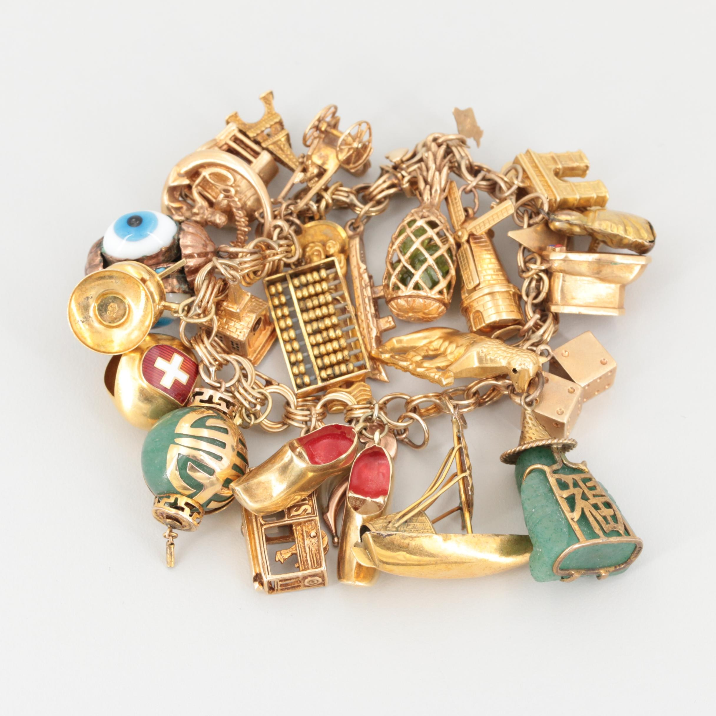 14K Yellow Gold Glass and Enamel Bracelet with 18K, 14K, and Gold Wash Charms