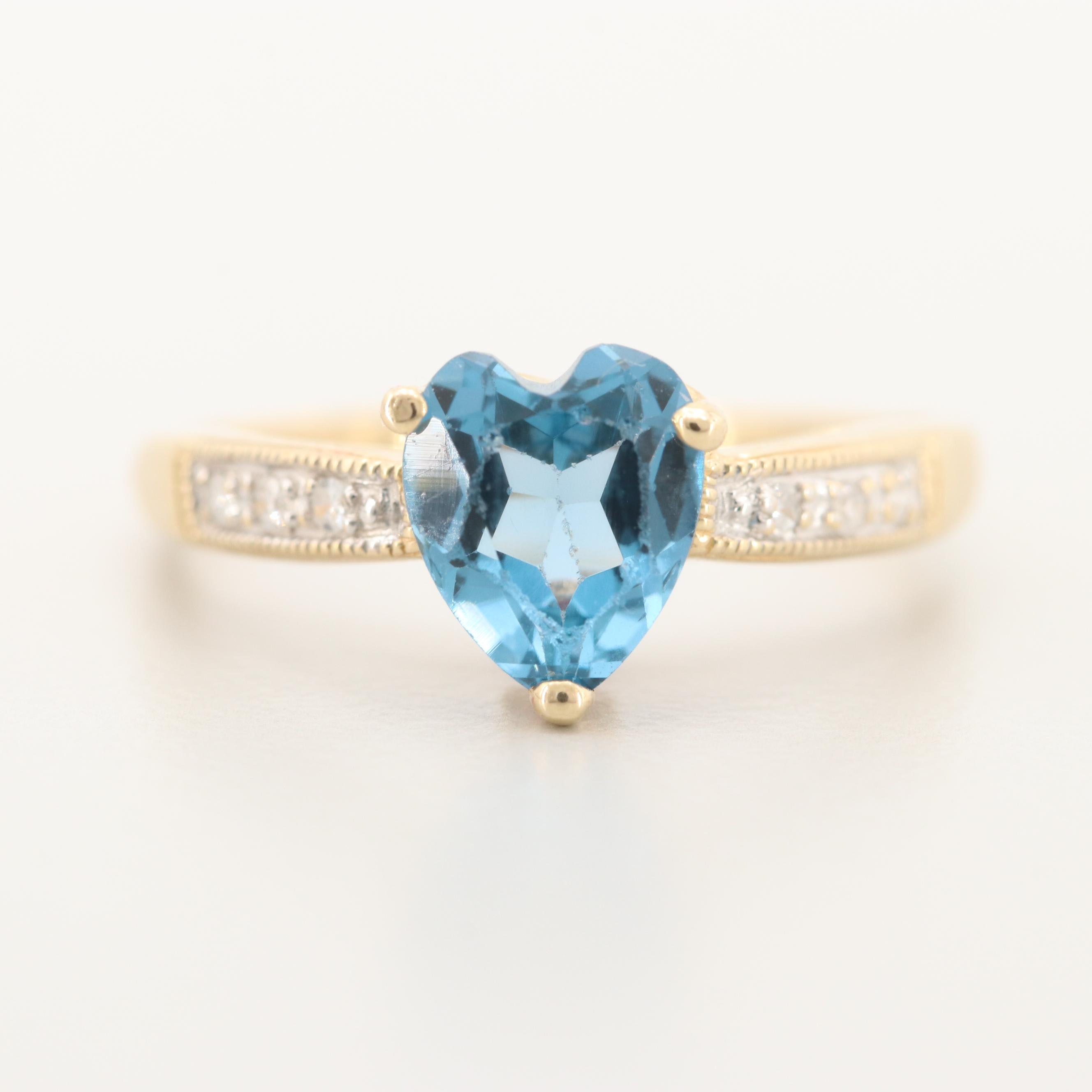 10K Yellow Gold Blue Topaz, Diamond and Synthetic Ruby Ring