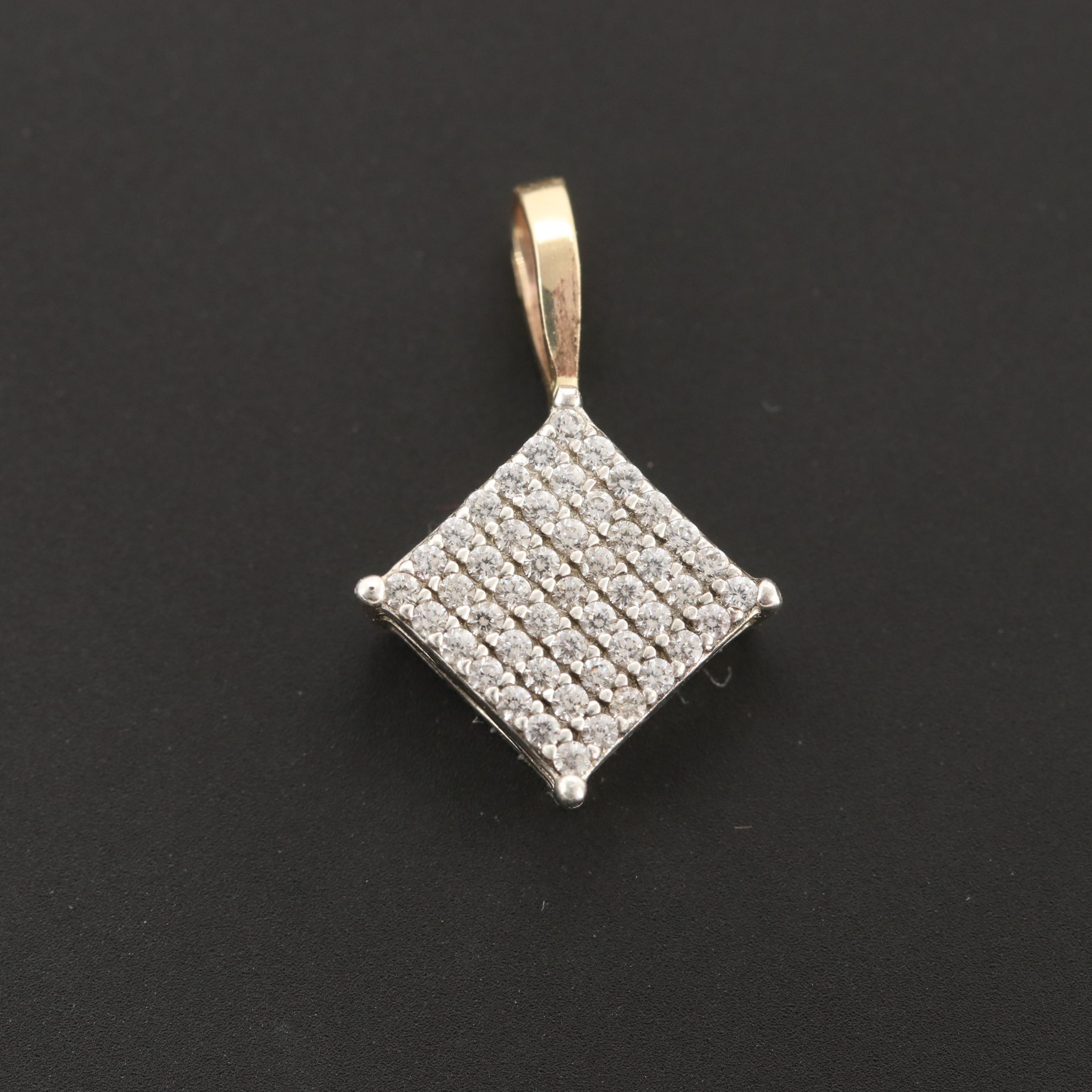 Sterling Silver and Diamond Pendant with 10K Yellow Gold Bail