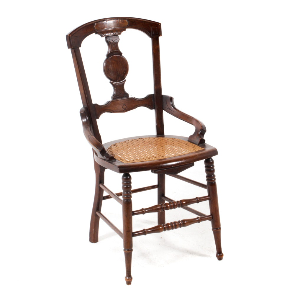 Antique Carved Wood Chair with Caned Seat