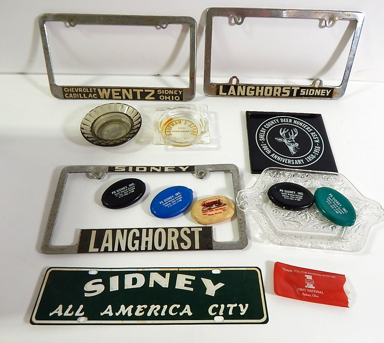 Sidney, Ohio Collectibles with License Plate Frames, Change Holders, Advertising