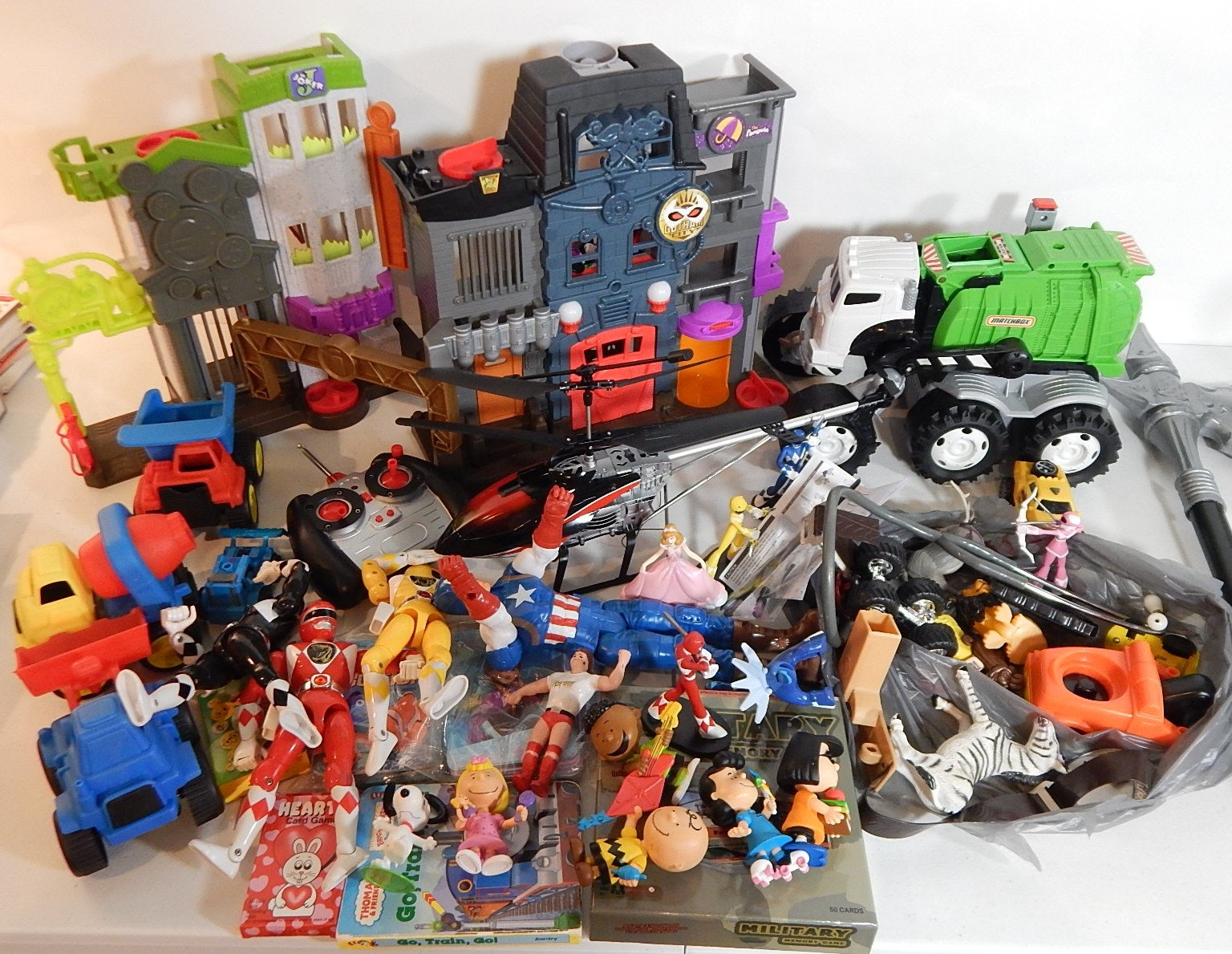 Assorted Toy Lot with Transformers, R/C Helicopter, Power Rangers,Batman Playset